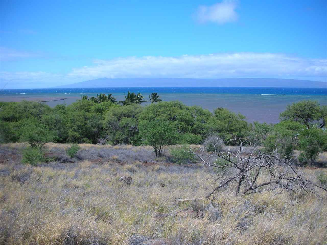 Enjoy stunning whitewater ocean views of year-round sunsets, whales in season, Lanai & Maui from this 2 acre lot in Kawela Planation III. With a great location right across from oceanfront One Alii Park, just a few minutes from Hotel Molokai & Kaunakakai Town, and 20 minutes to the airport, some of Molokai's most beautiful homes are on Makaiki Rd. This is the closest lot to the ocean; ready to build on with a leveled homesite, gentle slope, & installed water meter. Kawela owners share an oceanfront park & over 5000 pristine  mountainside acres. If you really want to get away from it all, Molokai is like going 70 years back in time to the Old Hawaii--perfect weather, no traffic (no traffic lights!), no buildings taller than a palm tree & few tourists..Say When!