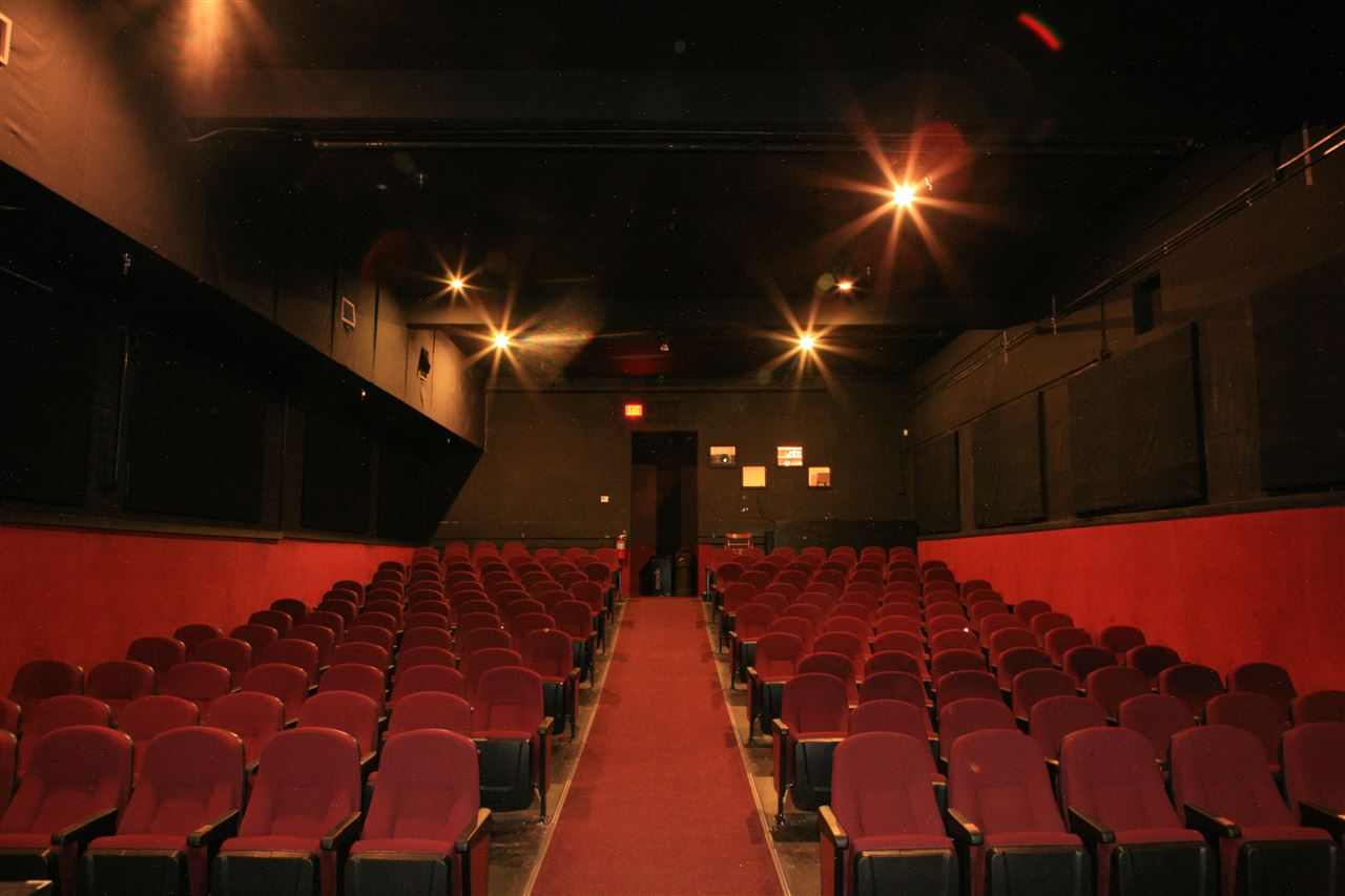 This property is the Old Theater located across the street from the police station and consists of two commercial condominiums.  The theater was upgraded before being closed and is a good opportunity for those with looking seeking this unique type of use.     The Basement portion of unit #4 (1872 square feet-highlighted)  is excluded from this listing but can be purchased at a price of $246,000.      Both Spaces are also available for lease.    The theater is a great concept for Mammoth, but needs a good owner/operator.  Ideal for independent films, showing westerns filmed in Mammoth, film festivals, pre-season ski, snowboard and snowmoibile movies, and so on.   There is also a stage which has recently been used for performing arts, music performances, and political forums.