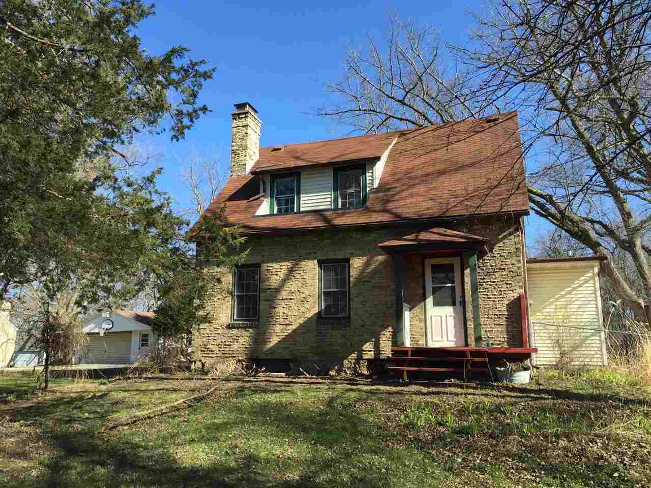 Private lot with over a half acre right in the City of Madison!  The house has hardwood floors and great character of an older home, but also includes an addition with a large open family room, spacious mudroom, and 2nd full bathroom.  New windows throughout.  Includes 2car garage and shed.  This property is eligible for the Freddie Mac First Look Initiative through 5/1/2016. Seller offering $500 credit for home warranty to O/O buyers.  All measurements are approx and buyer should verify for themselves.