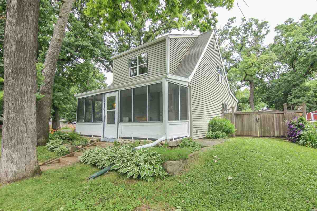 Don't miss your chance to be a part of desirable Bay Creek neighborhood! 2 bdrm Cape Cod with front porch & hardwood floors throughout. You will love the beautifully landscaped fenced backyard that includes a large deck, tree stump patio, & chicken coop if buyer desires. All windows were updated throughout 2014-2015 (new construction windows...not vinyl inserts) and are larger than the original windows. Brand new siding & gutters in 2015. Furnace new in 2012. Includes 1 car garage & carport! Bonus room has full size window overlooking the backyard! Measurements approx.