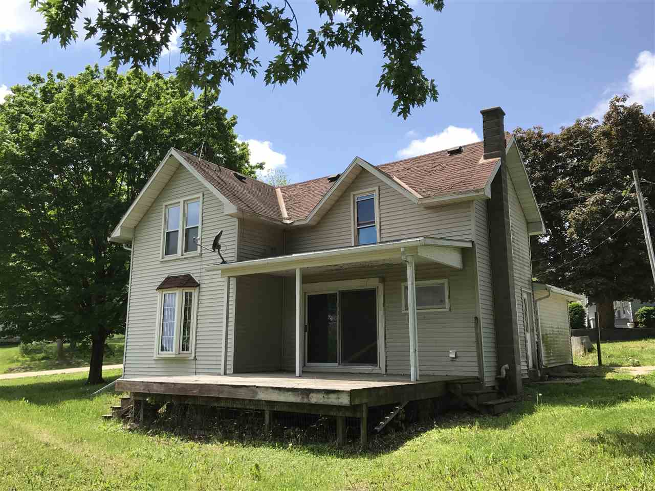 Located in the quiet town of Clarno just south of Monroe.  Enjoy the country views from the large covered front porch. 3bd plus big foyer area at upstairs landing, hardwood floors, 2car garage, big yard.  Per previous MLS, septic system was installed circa 2002.  1st time buyers, complete HomePath Ready Buyer course for up to 3% closing cost assistance. Restrictions apply.  Measurements approx; buyer to verify if important.