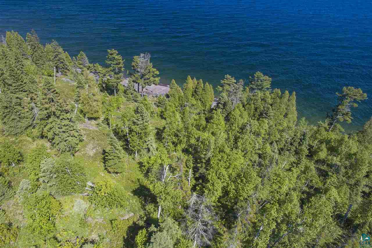 Breathtaking...Truly the only word to be used with this property! This 4.37 Acre property sits at the very end of a private road and boasts an impressive 580 feet of accessible frontage on Lake Superior. The lake frontage consists of copious amounts of flat ledge rock and some cobblestone beach as well. Multiple building sites, all of which give you the feeling of being right on top of The Great Lake! Property has been surveyed. Call today and start building the lake home of your dreams tomorrow!