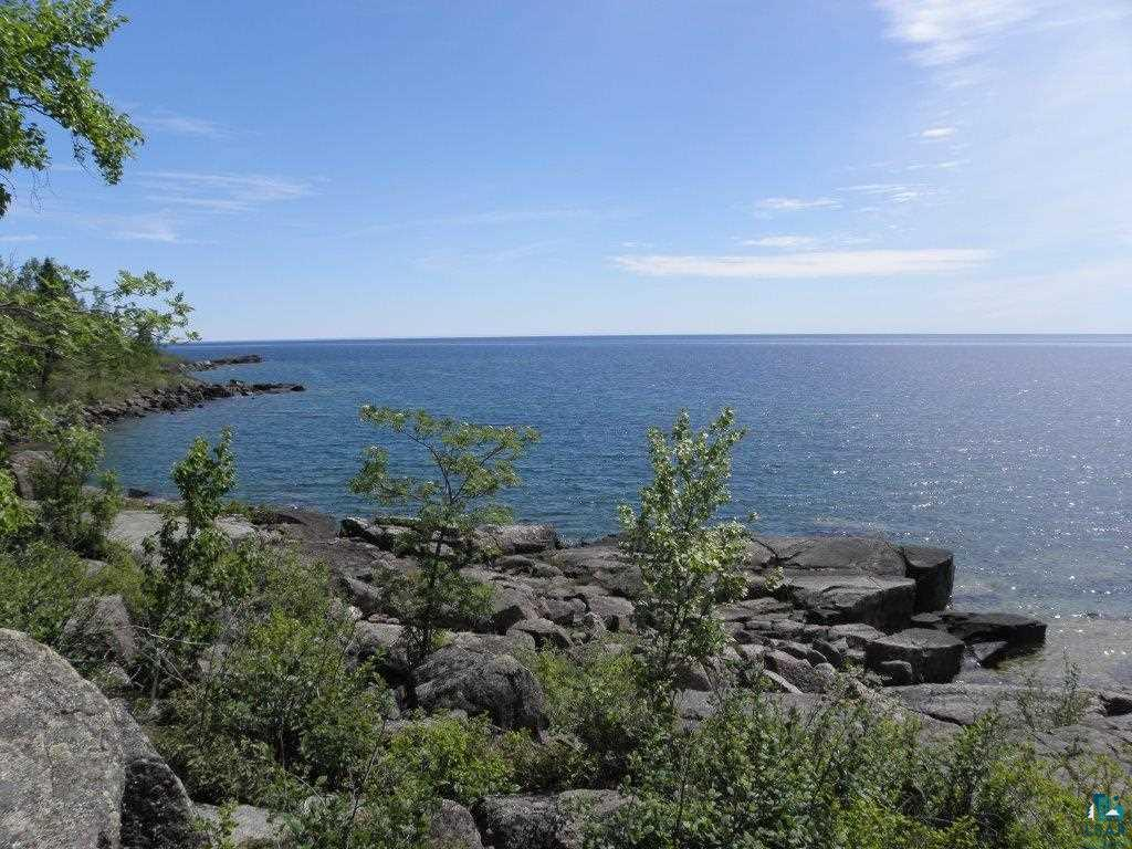Exceptional Lake Superior Land with wonderful building site offering panoramic views of the Big Lake! Tucked well off Highway 61 at Kings Landing, this parcel is ready to build with septic sites already identified. Very near to Split Rock Lighthouse and Tettagouche State Parks, enjoy hiking and biking from this pristine site! These truly are some of the most stunning views of Superior you can imagine!