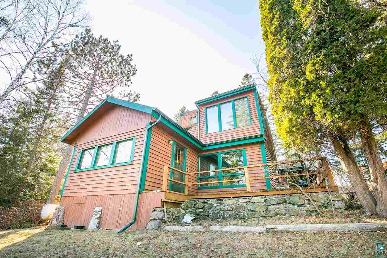 Built in the 1930's, History, Location, Views of Lake Superior, character, are just a few of the many things this property has to offer. Overlooking the marina in knife river from the deck with friends or gardening around the property, this address has it all.
