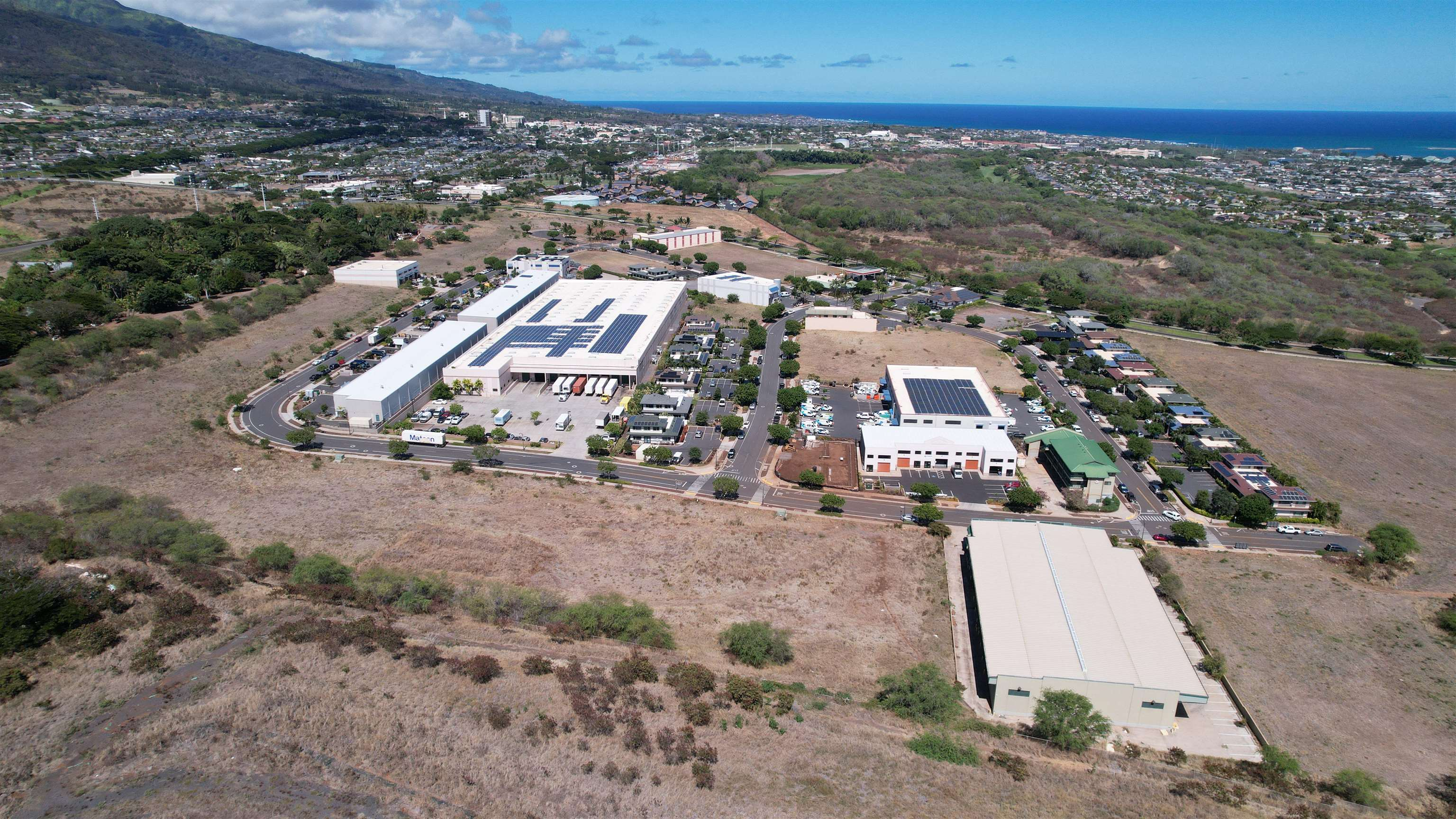 Fee simple vacant land parcel near busy intersection of Kuikahi Drive and Waiale Road.  VMX zoning allows for a wide array of uses.  Ready to build lot with drainage and utilities stubbed to site.