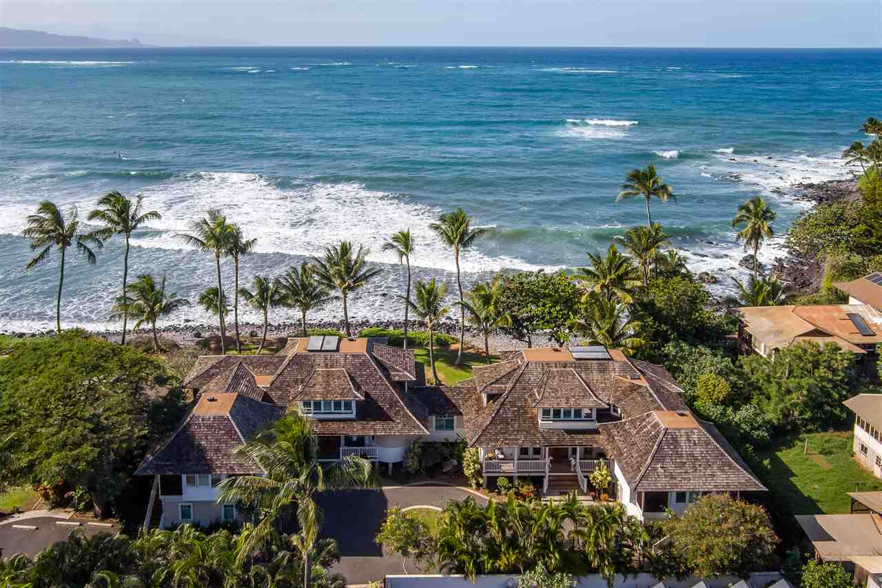 Take your leisure seriously. Representing the pinnacle in world-class oceanfront living, 137 Hana Hwy is a stunning oceanfront residence in the heart of Paia town that boasts unparalleled views of the pacific, an unrivaled location and an array of beautifully appointed amenities, truly making it a resort-like living experience. Conceived with the highest standards of luxury in mind, this 7,200 SF property features 6 bedrooms, 6 bathrooms, beautifully manicured grounds, a jacuzzi and two fully-appointed attached ohanas. Designed to offer its residents a lifestyle like no other, this home encompasses the best of indoor-outdoor living with seamless transitions from the modern interior to the resplendent outdoor lanais. Defining the main level, a spacious great room with brilliant floor-to-ceiling retractable glass doors that lead out to the lanai, illuminating the space and proving to be the perfect backdrop for the home's exquisite interior. A gourmet kitchen designed for world-class entertaining is planned with custom finishes, top-of-the-line appliances, and a stunning granite  center island, all bathed in light and dressed with unending views of the ocean. The main level is complete with a modern en-suite bedroom and a laundry room. Make your way up the spiral staircase and you'll find yourself at the home's thoughtful upper level encompassing, 3 en-suite bedrooms and a luxurious open-concept master suite complete with a spacious lounge area, ultra-modern en-suite master bathroom with resort-like walk in shower, dual vanity & spa soaking tub. The master suite also offers it's own private lanai, perfect for reading a book on a quiet afternoon or enjoying the watercolor painted sky as the waves crash below you. A spacious attached ohana echoes the main residence's open concept design and includes a kitchen, a charming en-suite bedroom and access to the main level lanai. Take refuge in the solitude of your private grounds or set out for the day as this residence is pe