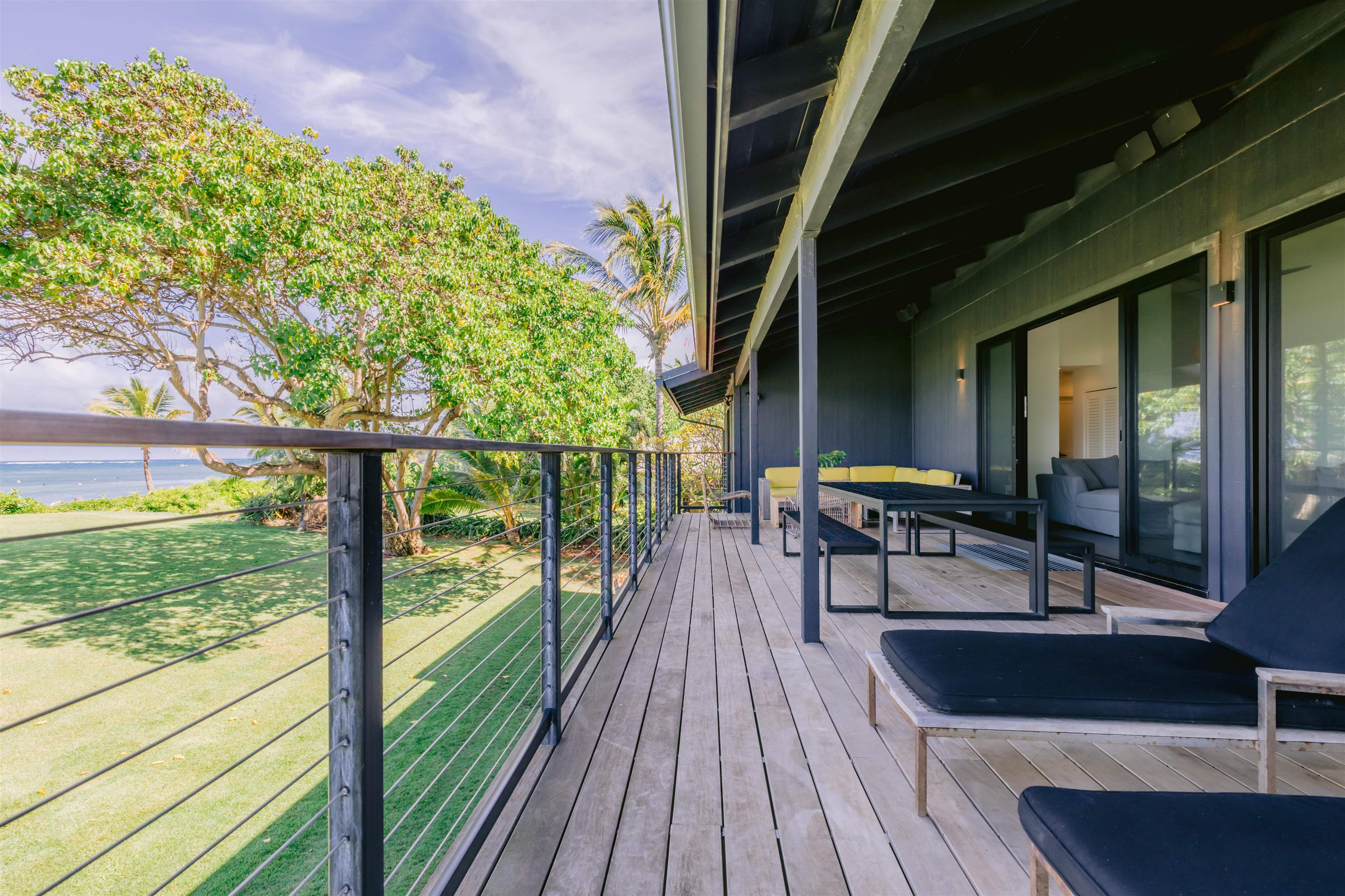 Located in the timeless beachfront community of Paia sits a modern, stylish private beach home. Poised on a lush grassy knoll with 170 feet of sandy beachfront, enter through a private gate to this .67 of an acre compound. Once inside, your world shifts and slows down, as the transition to beach life begins. The first home is a classic iconic over 1,000sf cottage built-in 1910. The main home is modern, and a comfortable 4,300sf beach home with all amenities. Sleep in while you gaze from your bedroom across your compound to the turquoise blue ocean. Enjoy an easy 3 mile stroll of beach walks right from your front door.  The entire compound is well set up for indoor-outdoor living amenities  The covered lanai has sweeping Pacific Ocean views and is complemented by modern and cozy living areas, including a chef-style kitchen, clean white marble bathrooms and 3 car garage. Extra space is intelligently designed into multiple areas offering plenty of opportunities for weekend gatherings, ohana, beach time, and beautiful sunsets. Walk into town for over 13 restaurants, mana foods, and 30 boutiques. This is a rare opportunity to be right in the heart of Paia and on a world-class white sand beach. Beautifully furnished totally turnkey just bring your bathing suit and surfboard.  Owner interested in selling a 50 percent interest where both owners would have 6 months each.