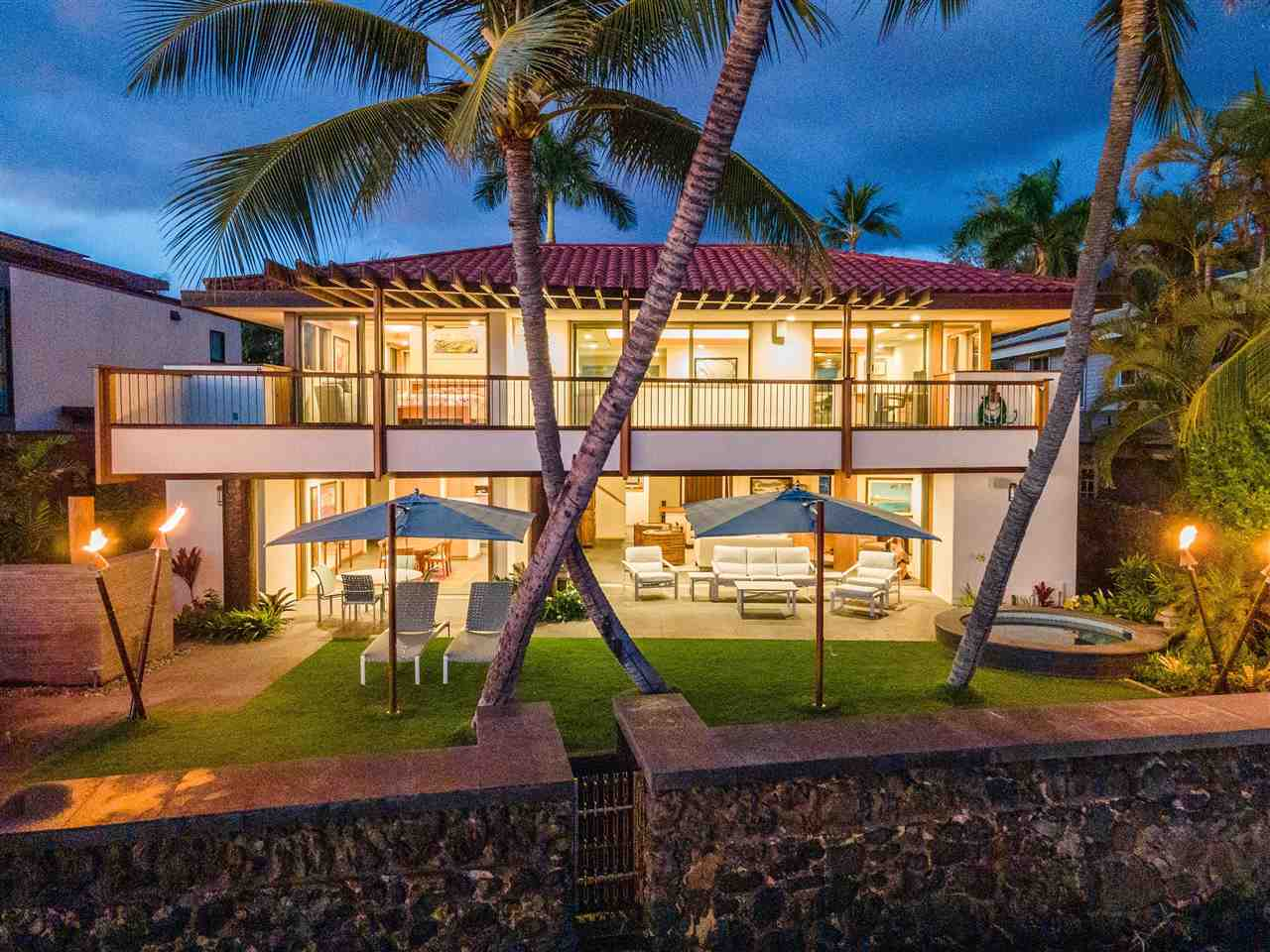 """1033 Front Street is for the most discriminating purchaser: Exquisitely well-appointed Modern-Hawaiian Oceanfront Estate with just-completed total renovation to modernize this iconic Front Street location. A short distance to popular """"baby beach"""" and to Historic Lahaina Town, which is the """"entertainment capital"""" of Maui with world-class restaurants and and shopping. This sophisticated oceanfront property enjoys the tranquillity of the ocean at your doorstep wile embracing all of the qualities of the ultimate Maui lifestyle. Enjoy the seamless combination of indoor/outdoor living in this Frank Lloyd Wright inspired design with large pocket doors and high ceilings. The Modern design features a plethora of different woods including koa, maple and cedar combined with basalt rock (lava) gives the home it's modern yet Hawaiian appeal. This private-gated property features 2 en-suite bedrooms, a media room, state-of-the-art chef's dream kitchen, surround sound, a large office with stunning views and spacious outdoor lanais. A truly remarkable home in a idyllic setting."""