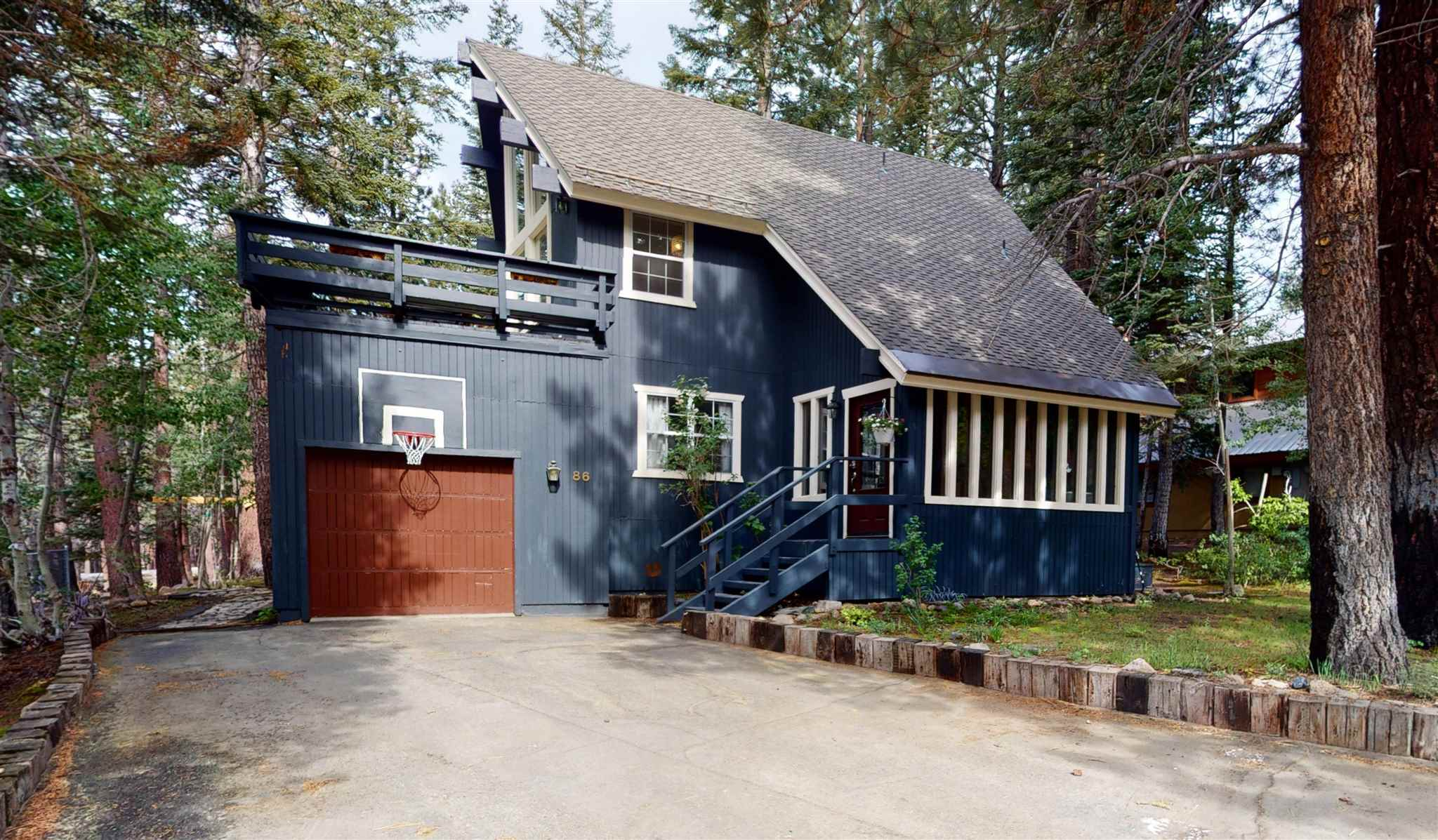 Village adjacent location and treed forest views! Well maintained 3 bedroom plus loft home with 3 full bathrooms located in the highly desired Mammoth Knolls neighborhood. Walk to the Village to enjoy the shops, restaurants, or jump on the gondola to go skiing. In the summer you have easy access to the shuttle hub at the Village to go around town and mountain biking. Sunny bright open floor plan with huge windows and beamed vaulted ceilings in the living room and loft. Enjoy summer dinners on the large upper deck, or roast smores on the lower deck area overlooking the forested back yard with a horseshoe pit. The upstairs loft can be a sleeping area for kids/ guests, or a bright and sunny office space. The home is equipped with forced heating, a pellet stove in the living room, and a gas fireplace in the downstairs bedroom. There is a newly custom built mud room bench with cubbies along with a new tankless water heater, and new forced heating system. One car garage and additional storage space off the downstairs deck. Don't miss this opportunity for a home in a prime location to make your own.