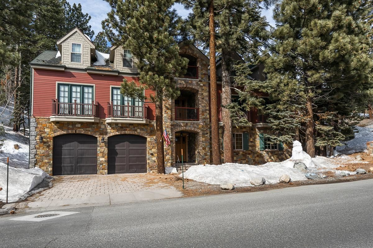 Amazing location, adjacent to The Village. Walk across the street to the Gondola, Restaurants, and Shops. Custom built home by Ames &McCullough Construction from Rancho Santa Fe. Built for their families to enjoy all that Mammoth has to offer every season of the year. Private closets in the garage, and throughout the house, in the kitchen and guest bedrooms for storage for each family. Current owner has added a large outdoor living / deck area with spa, BBQ and fire pit. Plenty of room for the whole family with great room living area, and top floor sleeping lofts. Also has a two bedroom apartment on the bottom floor with kitchen, and washer / dryer. Perfect home for multiple families or a corporation