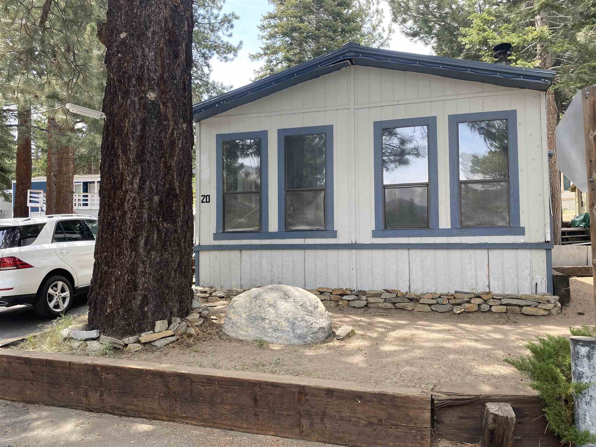 AS IS, Cash only purchase. Sunny south facing manufactured home with mountain views. 2 bdrm, 1.25 bath, 2 car parking, fixer upper at The Ski Trails Mobile Home Park. Approx 800 sq ft. Ski Trails requires a completed application be approved before a prospective buyer can take possession or close escrow. Agent recommends buyer have a professional home inspection.