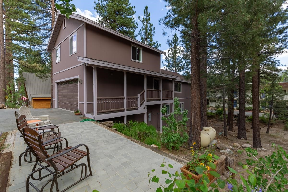 """Great family home, lots of light and beautiful views from the south facing dual pane windows. Large 2338 square foot house with a roomy 2 car garage on a 7400 square foot lot. Complete """"to the studs"""" remodel finished in 2009. Living floor is an open concept with a granite countertop kitchen, bay window, and breakfast bar. The living room has sliding glass doors with access to the large back deck complete with a spectacular view of the Sherwins to Mammoth Crest. Lower floor has 3 bedrooms including the master with an en-suite bathroom and a walk-in closet. Laundry area is also on the first floor. The 3rd floor bedroom and attached bath is a potential ADU (buyer to confirm with the Town of Mammoth Lakes). Forced Air propane heating throughout the house, living floor has an EPA II wood burning stove. Extra large driveway with room for all your toys. Paver patio and flower garden (with  timed sprinklers) by front porch."""