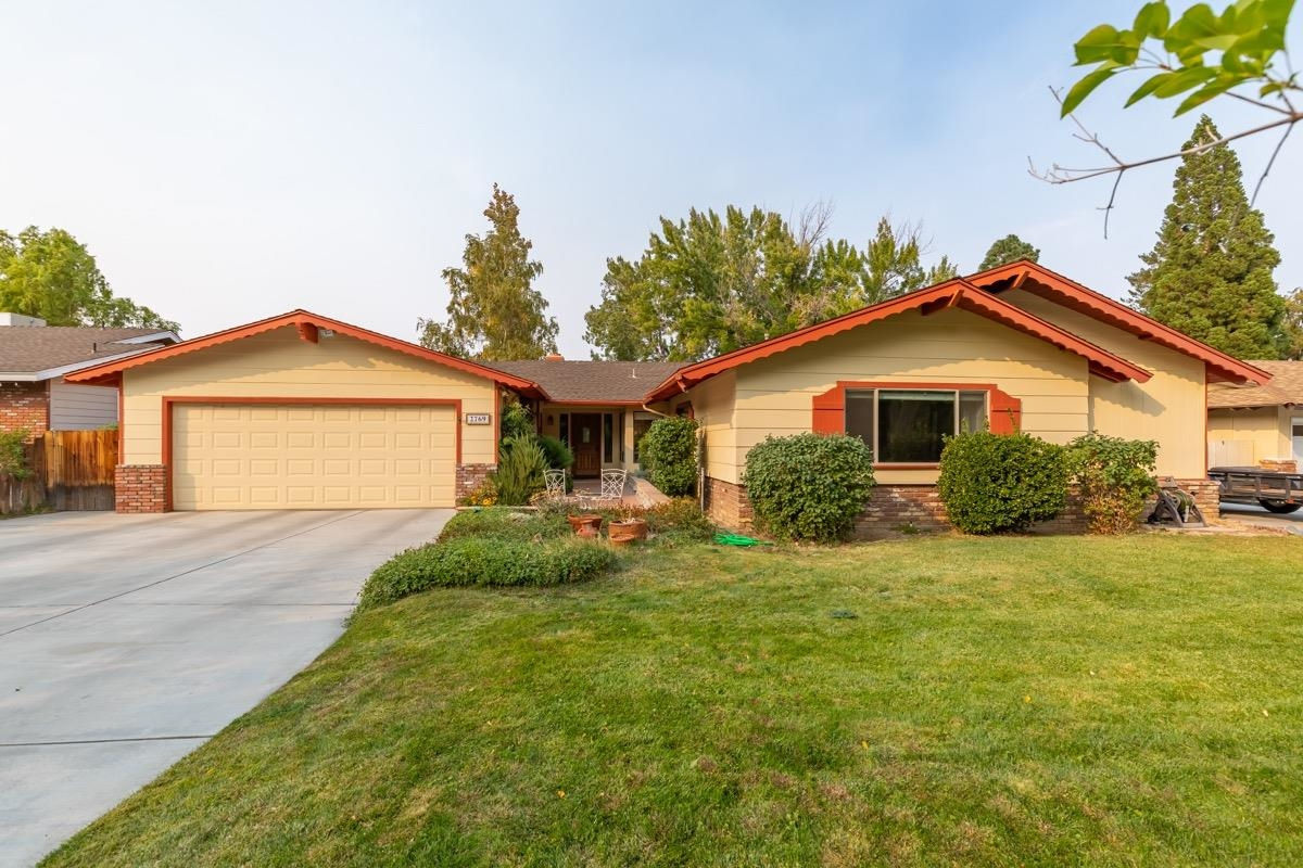 Beautiful 3 bedroom w/office, 2 bath, ranch style home with many updates and located near off road trails and walking paths. Recently remodeled kitchen with spice racks, pull out pan drawers, granite counters and nook with picture window. Master bathroom also updated with large tiled walk in shower and new vanity. Oversized garage with room for boat parking, workshop or gym. Great entertainment home with slider to the stamped concrete patio that overlooks the pond and stream. Garden beds, garden shed and large side yard for extra storage. RV parking off street. Copy following link to Matterport 3-D video:  https://my.matterport.com/show/?m=e8G1iYYNN94&brand=0
