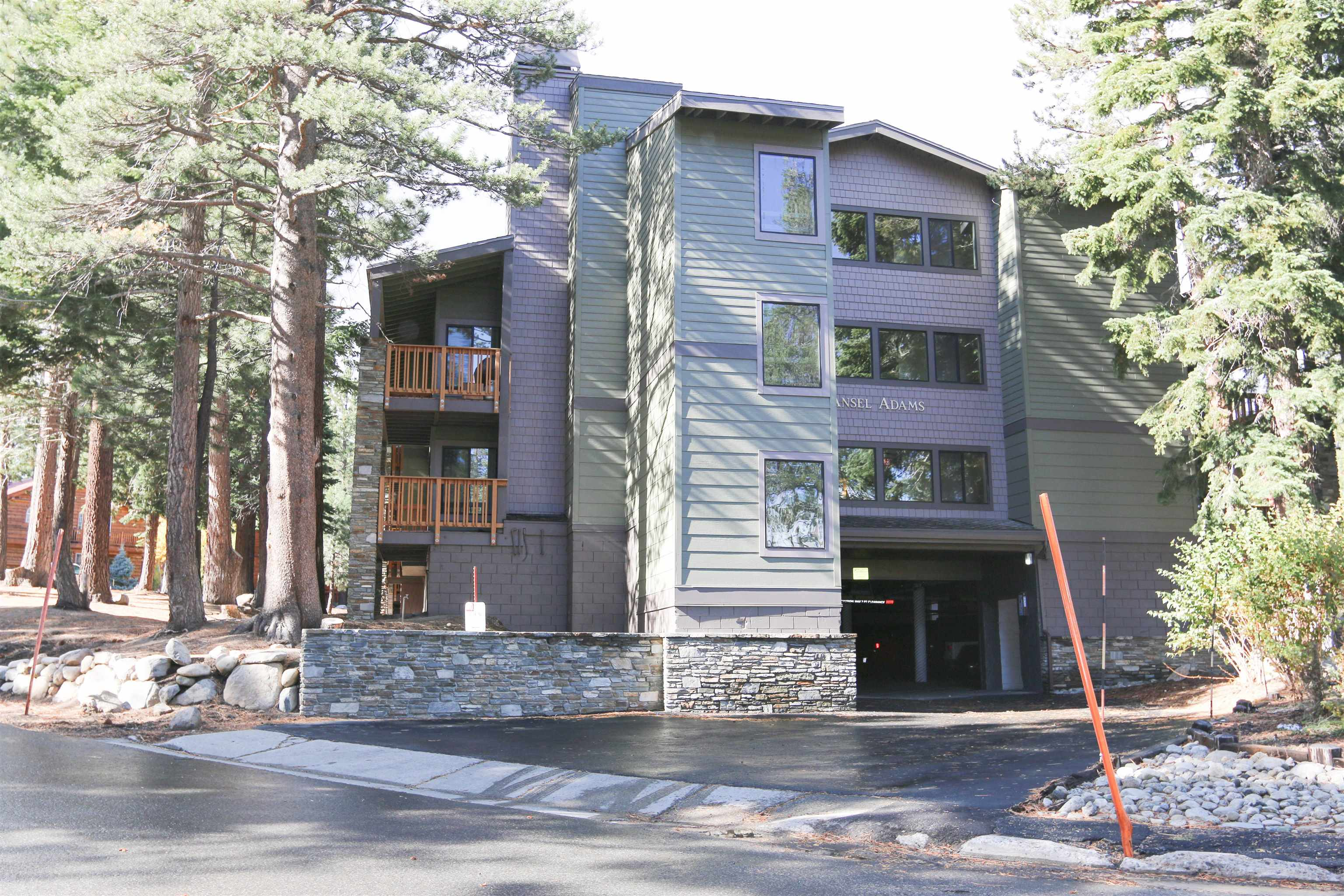 Beautifully located second floor corner 1 bedroom / 1 bath condo at The Summit. Wrap-around covered deck overlooks forested area and residential neighborhood. South and Sherwin Range views. Located directly adjacent to elevator and stairwell for easy convenience to understructure parking and street level and shuttles. Walk or jump the shuttle to Eagle Express and Eagle Base. Directly across the street from the Sierra Star golf course and the Town bike paths. The Summit is in great shape with modern exterior and interior hallway upgrades. Well managed and well funded HOA. HOA fees include basic cable TV and Internet. Buyer shall be responsible for fireplace retrofitting but propane gas is available and makes an excellent new fireplace option. Owner storage closets available in unit. Use now and remodel later! Check out the video tour.