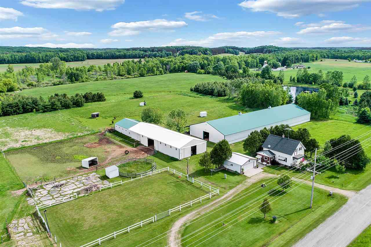 Perfect opportunity to raise, train & board horses on this 10 Acre Farmette! 12 interior stalls, a huge 66x200 indoor riding arena, 60x100 outdoor arena, 6 fenced pastures w/5 pasture shelters, a tack room, wash stall, removable stall dividers for foaling & a breeding/foaling area + much more. The 1.5 story home offers hardwood floors, eat-in kitchen & remodeled main level full bath w/laundry area. Updates include newer water heater, softener, exterior paint & roof. There are 2- 2.5 car detached garages Plus Fruit trees & perennial gardens. MUST SEE TO APPRECIATE ALL THIS PROPERTY HAS TO OFFER