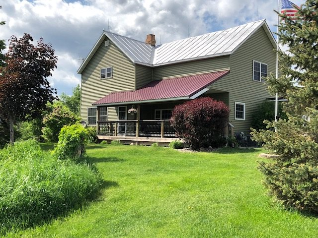 Country living at its finest and a Fantastic Location!  Remodeled farmhouse on 20 ac featuring 4 bdrm, 2 full baths & is located on a quiet country Rd,  convenient to all activities. Nestled among popular lakes, golf courses, shopping, rec trails & easy drive to Green Bay, Marinette and Oconto. Home was totally gutted, includes new kitchen, done in the last 5 yrs, all new Pella windows, new furnace, new elec wiring, Vermont Wood Stove, new flooring in Jan 2018. The newly done front porch simply adds  charm. Auto Watering & elec fencing on 2 front pastures. 52x22 garage with overhead heater!