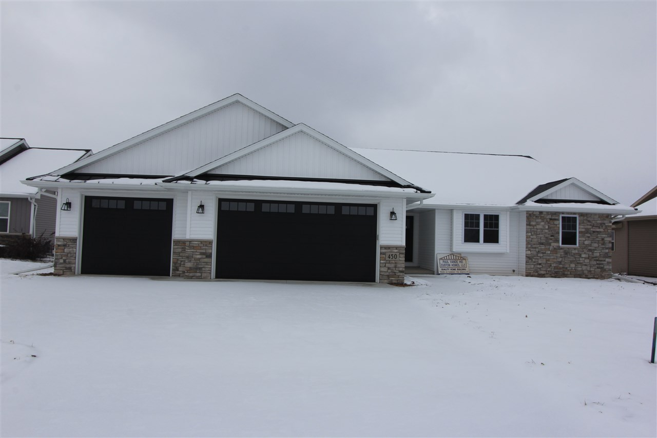 QUALITY BUILDER! Hard to find new construction split bd ranch on nice lot in WRIGHTSTOWN. Home features numerous bonuses incl foyer entry, spacious lg 3-car garage w/ flr drains, cathedral ceilings w/ comfy gas fireplace, spacious bdrms w/ lg master suite w/ tray ceiling, huge walk-in closet and lg master bath. Awesome kitchen design w/ a lg island and pantry. Lower is stubbed for a bath w/ exposed windows. Central air included. Focus on Energy home! NUMEROUS UPGRADES! Double hung windows, dimmers, 2 garage dr openers, etc. QUALITY BUILD! Make this your new home today! Ready to move right in!!