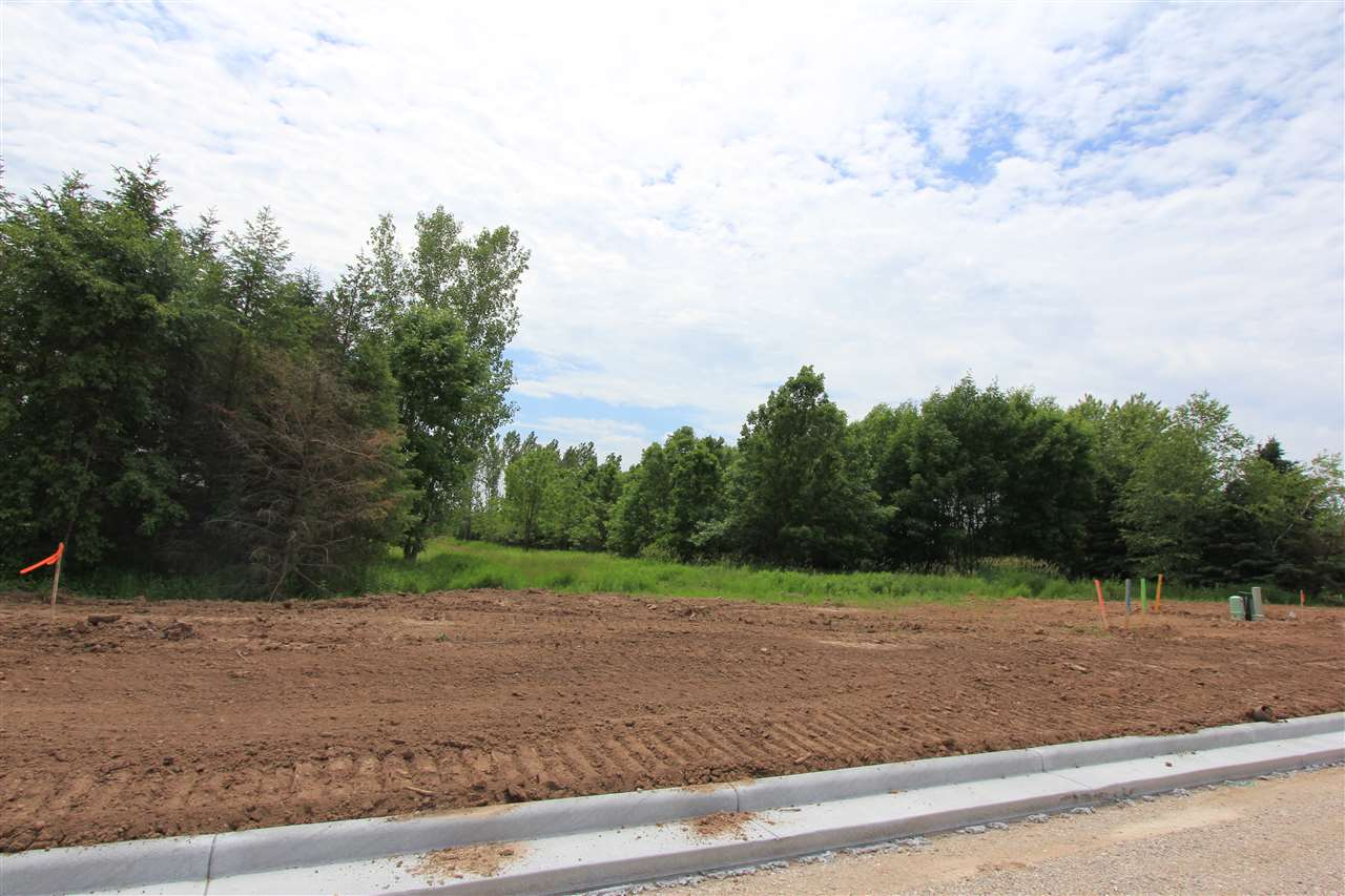 Great lot in new Pine Trail Crossing East De Pere subdivision ready to be built on! Located near Altmeyer School and Fox River State Trail! Builder exclusive with Paul Vande Hei Construction. Choose from one of Paul's spec builds or create your own custom!! Call or set up an appointment to talk about pricing and build options. Taxes not yet determined... TBD