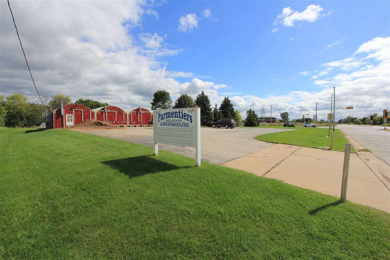 EXCELLENT hard corner property located on a very busy Bellevue corner. The property consists of the old Parmentier's greenhouses which include the main green house, 48' x 64', an additional 96' x 28' green house and 2 - 96' x 16' green houses. In addition a large storage barn and the 1118 sf ranch home w/ 3 bedrooms and a full bath. The 2 parcels included are B-269-2, commercial zoning, and B-269-4, residential zoning. Easily convert the residential status to commercial or use as a perfect income producing leased home! The home has had several updates... Numerous ideal uses for this corner!