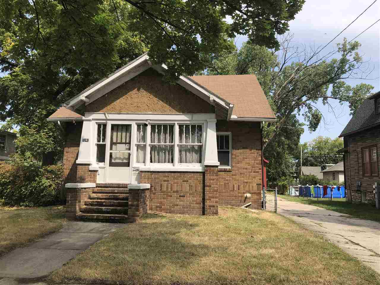"""4 bedroom, 1 full bath 1.5 story home in Green bay. Features formal dining room and large 28x30 foot garage with loft. Property sold """"As-Is, Where-Is""""."""