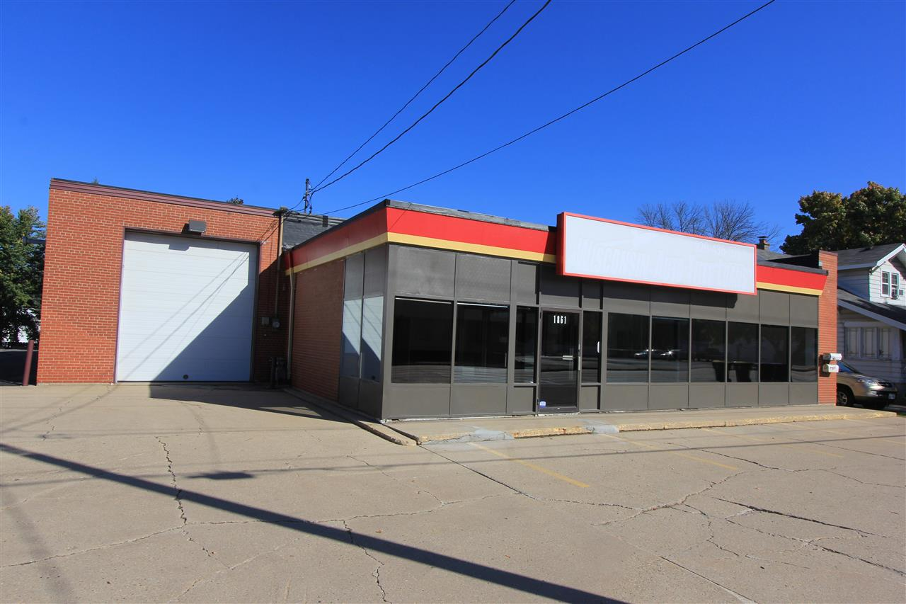 3171 sq ft of nicely updated retail/office/specialty space w/ attached warehouse and storage avail at $8 per sq ft N/N/N. This space offers a built-out showroom or office area, attached 36'x36' warehouse/garage w/ 14' overhead door, additional bonus storage rm, private bath, ample parking for clients and customers and located on a very high traffic corridor on Green Bay's Northeast side w/ easy access to Hiway 43! Ideal for NUMEROUS types of business. Perfect for retail w/ storage, auto or truck detail shop, service industry related businesses, and the list goes on... 24 mo. lease minimum