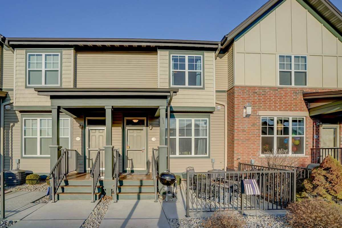No showings until Friday, 3/23, 4:00pm. Very well-maintained 2bd/1.5bth townhouse condo in Verona. Laminate, hardwood and tile flooring throughout! Newly installed on stairs and throughout 2nd floor. Lovely patio for cooking out or entertaining. Backs to large open green space. Heated garage with 2 spaces. Keep your valuables secure in the large built-in safe in the master bdrm, and feel secure using the peephole in the front door! Walking distance to nightlife, shopping, fitness center and trails. Front window living room blinds will be replaced prior to closing. All measurements approx.
