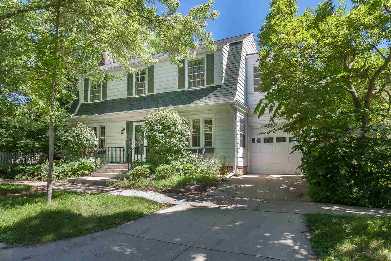 This beautiful, light-filled, Colonial home in one of the most desirable neighborhoods in Madison is full of the charm & character you'd expect from a house built in 1910. Architectural details include numerous french doors between rooms and fantastic outdoor spaces, original hex tile floors in the entry, gorgeous maple & oak floors, wood burning brick fireplace w/ornate detailing and substantial trim and molding. The remodeled kitchen suits the home perfectly while offering modern convenience. Fenced yard, 1-car garage and lots of LL storage. Walk to Monroe St! SRM $495,000-$520,000