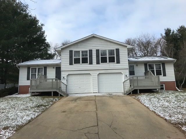 Great location!  Centrally located and backs up to some trees and the school property.  Each unit has 3bd/1.5bth, deck in private backyard, and attached 1 car garage. Lower level has exposure for possible 4th bedroom.  Unit 2952 has new flooring and paint throughout along with some other updates! Ready for owner-occupant OR choose your own tenants! Measurements are approx.