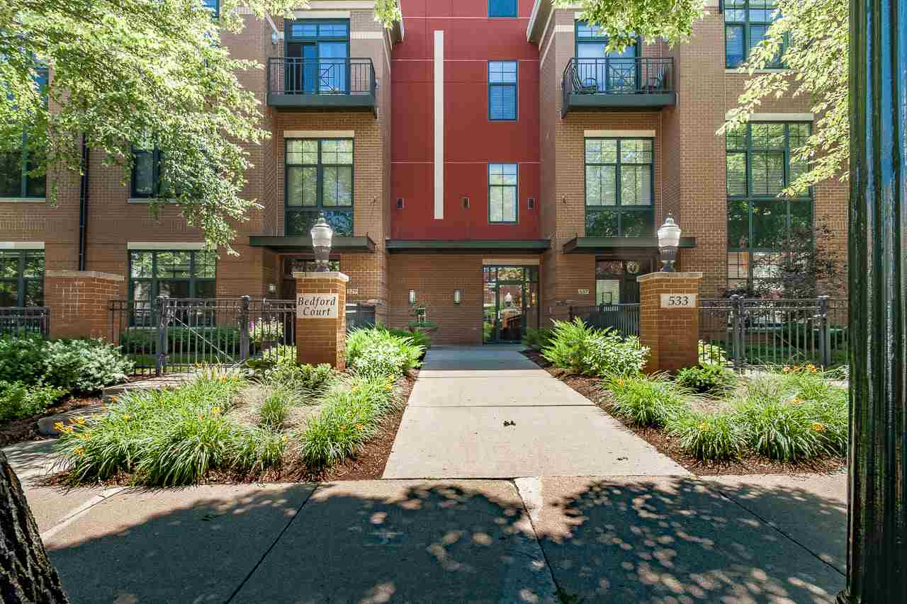 Downtown living at it's finest! Just 5 blocks to the Square & 3 blocks to Lake Monona, this sweet, 2-story, walk-up condo has a private, fenced entry + patio. Inside you'll find an open floor plan w/large windows and 10' ceilings, and a bright kitchen w/granite counters and stainless appliances that overlooks the dining area and the living room with its gas fireplace. The upper level has 2 spacious, ensuite bedrooms + laundry and lots of closet space. Incl. 2 parking spots, a storage unit, and a courtyard with beautiful landscaping that's perfect for parties. Condo fee $367.