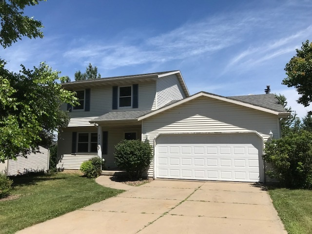 Opportunity knocks - 3bd/2bth home under $250k on west side of Madison! Located in quiet Sandstone Ridge neighborhood, this house offers an open floorplan with vaulted ceilings, fireplace, 2 main floor living rooms, LL rec room with walkout to backyard, 3 bedrooms plus an office, 2 full bathrooms. Enjoy the views from the balcony and bedrooms!