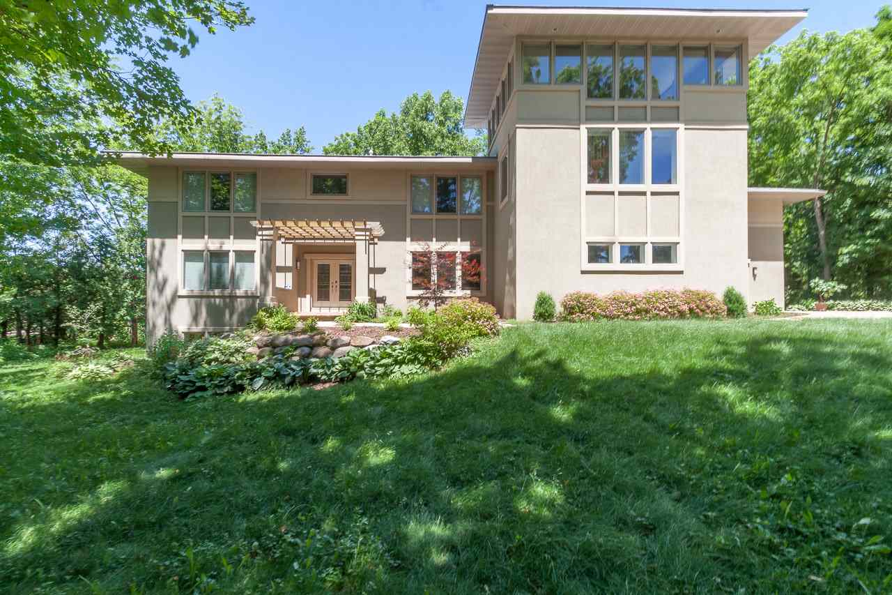 This stunning, modern beauty on a wooded 1+ acre lot is beyond fabulous. Built using a highly energy-efficient, insulating concrete, the craftsmanship is breathtaking. An open, gourmet kitchen feat. walk-in pantry & banquette. The LL offers endless surprises—a hidden theater,  kitchenette, exercise rm, fam rm & 2-way  fireplace. The owner suite is spectacular w/sauna & infinity tub. Spacious interiors, walls of windows, 4 fireplaces, 2-level screen porch, 4-car garage, sunny library that leads to a flex room w/tree-top views, an office/au pair room w/private entrance, wet bar and so much more!