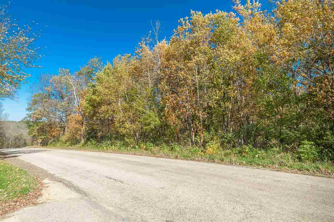 Currently zoned RH-2. Zoning may be changed to RH-4. Choose your own builder. Beautiful, 4.5 acres,  all wooded on top of a ridge. Electricity is currently across the street.  Convenient to Madison, Verona and Mt. Horeb. Shared driveway agreement available.