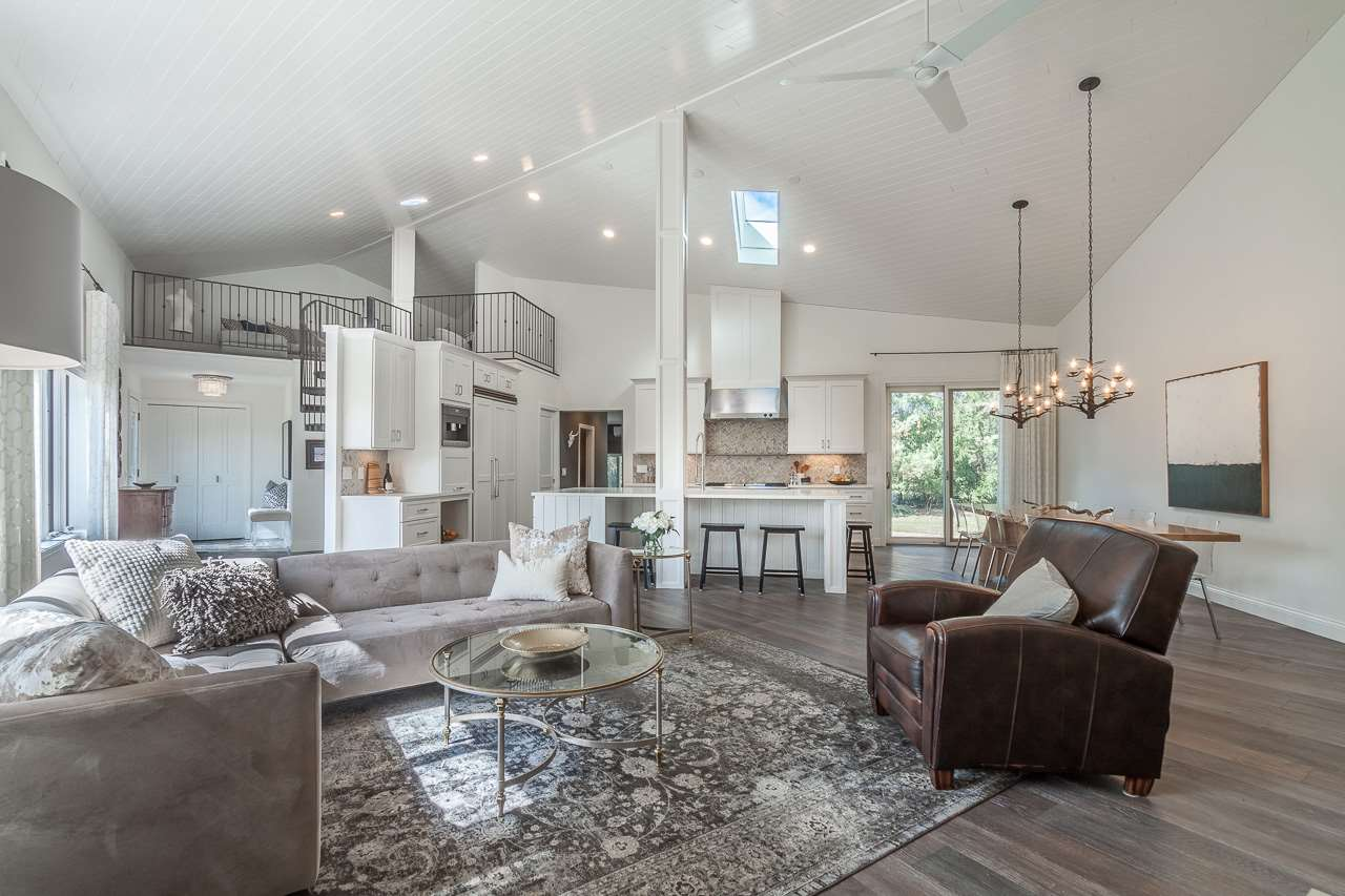 Modern, striking lines + an uncompromising sense of style are what you'll find in this stunning, completely renovated contemporary home on 2.29 acres. Configured to make the most of the views, this home connects to the natural beauty of its surroundings in every single room. The large, open-plan main floor is perfect for entertaining w/a spectacular chef's kitchen + easy access to the patio. The serene owner's suite and 2 other bedrooms that share a spacious loft—perfect for a play area, are on the main level along w/a fam room, and awesome laundry/mudroom. LL walkout rec room + guest room. Love!