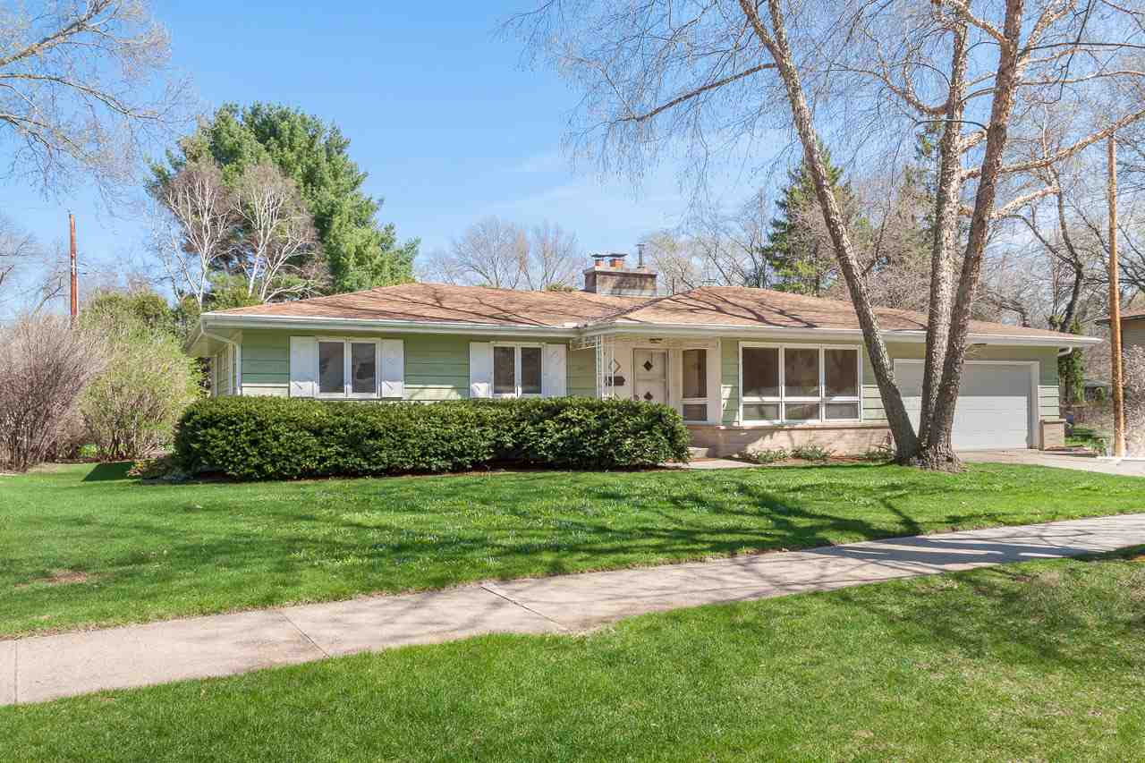 """Are you a midcentury modern lover who has been looking for THE house to make your own in Hill Farms? Prepare yourself for pure joy.  1957 Parade Home on a quiet, tree-lined street, just a short walk to Van Hise/Hamilton & Hilldale is ready for your love. It's a """"fixer-upper"""" but the bones are to die for. The newer 20 x 15 sunroom overlooking the gardens and private yard might be all it takes to wow, but there is so much more. A main floor owner's suite w/full bath, attached greenhouse, sprawling, finished lower level & a living room that is (or will be) perfect. Character galore!"""