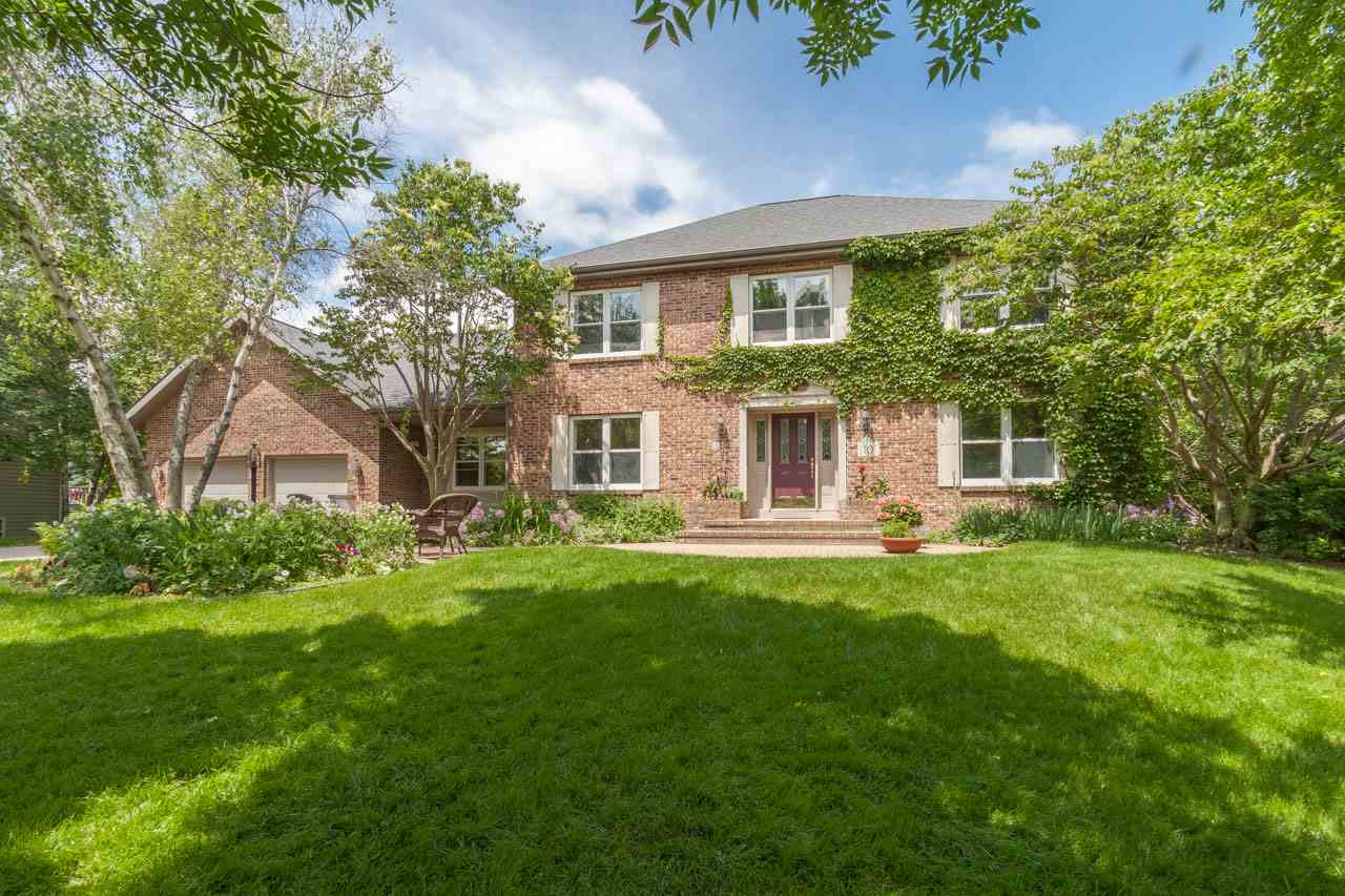OPEN HOUSE 6/23/19 CANCELED. This Colonial on a quiet cul de sac is a classic beauty—a private oasis in the city w/a lush back yard that backs to green space. Inside, you'll find a modern floor plan that makes the most of the natural light. A lovely, remodeled, eat-in kitchen opens to the deck via glass doors, the dining rm w/gorgeous crystal chandelier & living rm w/charming brick fireplace flanked by built-in shelves. The main floor includes a den, laundry rm, mudroom + powder rm. A bright LL features a large rec room, bedroom + full bath. An owner's suite w/walk-in closet + sunny bath is an exquisite escape from the day. SRM $499-$510K