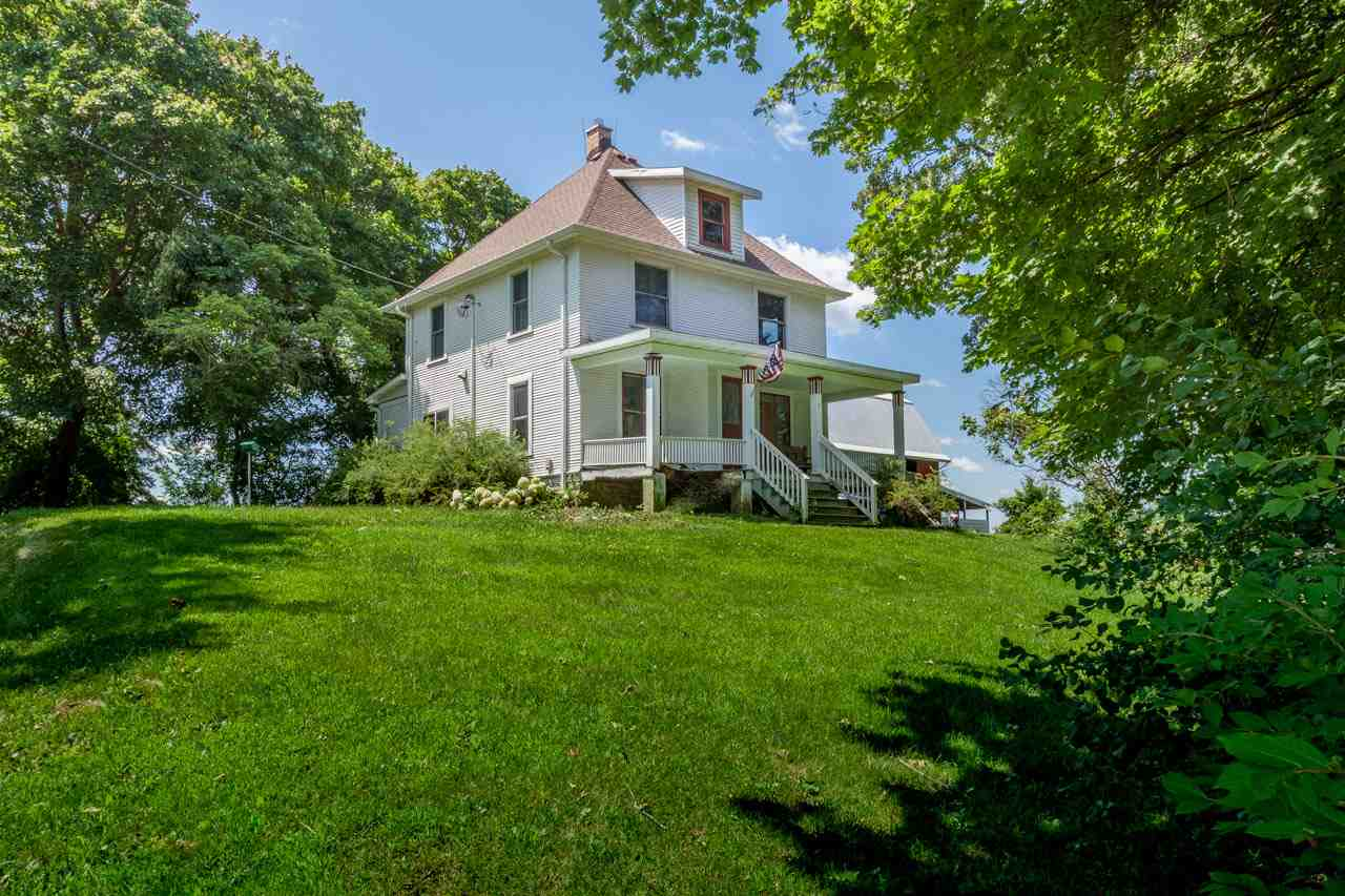 Ever dreamed of escaping to the country without really leaving the city? Now is your chance! This lovely farmette on 56+ acres is right in the City of Fitchburg. Enter through the charming, covered front porch after making your way down the long, winding drive past vibrant gardens and fields. The sunny main level includes two large living spaces and a remodeled kitchen. Upstairs you'll find 3 bedrooms. With a 30 x 50 barn with two stalls and a hay loft, a 12 x 14 utility shed and a 30 x 80 pole/utility building with four stalls, you'll have plenty of space for animals and equipment, not to mention endless serenity.