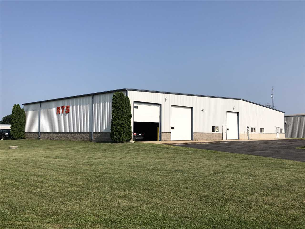 Warehouse FOR RENT $4,000/ month rent at 564 Water Street, Evansville, WI. 80' x 120'. 4- 14' x 12' overhead garage doors. 1 drive through bay, floor drains, 2 offices, 1 bathroom. Loft storage and large blacktop parking lot space available. Great condition! On the Truck route.