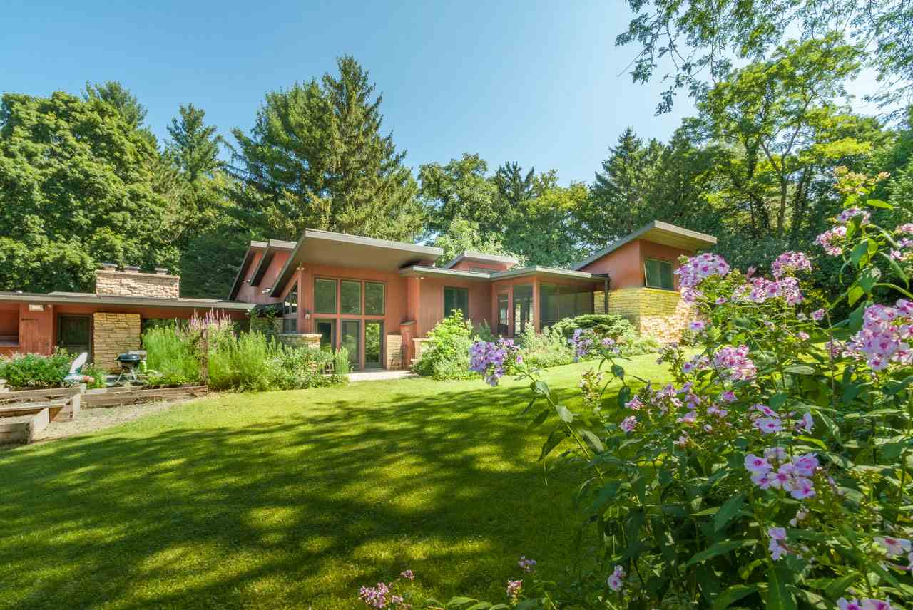 This stunning Highlands beauty sits on 1.3 secluded acres. The original Usonian exterior blends w/ the high-end upgrades & remodeled open-air design of the serene interior. An expansive kitchen w/professional-grade appliances + dinette will delight the chef in the family. The living rm invites you in for cozy evenings w/beamed ceiling & floor-to-ceiling slate wb fireplace. An exquisite owner's suite w/breathtaking spa bath, huge closet/laundry room, Japanese courtyard garden & screen porch. Indoor pool w/sunroom, wine cellar, 6-car outbuilding, formal dining rm with fp, library, office & several outdoor spaces. An amazing home!