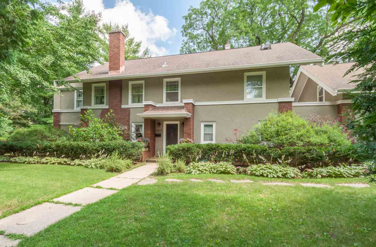 As if the awe-inspiring, lush, private, tiered yard w/stone paths + reflecting pool w/fountain aren't enough to take your breath away, the interior of this Nakoma beauty will seal the deal. At the heart of the 4 BR home is a stunning updated kitchen (2014) w/a long island w/Wolf gas cook top + seating, built-in buffet w/SubZero beverage cooler, Wolf double wall ovens, SubZero refrigerator & dinette. Formal dining room is in the Craftsman style w/wood beam ceilings, as is the expansive living rm w/brick fireplace + french doors to a den that leads to the deck. The owner's suite w/serene spa bath is pure luxury. So much to see & love!
