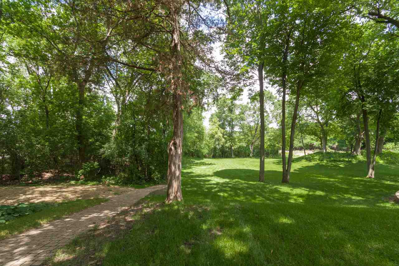 Great lot, over 1/2 acre with some beautiful trees. Some rolling, some flat. Feel like your are out in the country, yet the city is right there. A very special property perfect for your dream home! Bring your own builder! Borders Cherokee Marsh. Lot dimensions are approximate-CSM 7246.
