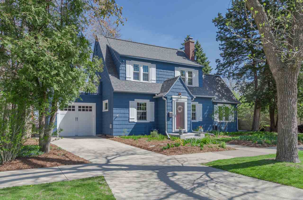 This inviting 1925 Colonial is perfectly located in one of our most desired neighborhoods.  It's within walking distance of great local restaurants, shops, all Monroe St has to offer, West High, UW &VA Hospitals, + Camp Randall. If that weren't enough, it's an incredibly lovely place to call home! Original details like arched doorways, built-in bookshelves, gleaming wood floors & hexagonal tiles give the home character+charm while a remodeled kitchen w/stunning cabinetry, a butler's pantry, and modern amenities make it a pleasure to live in everyday. An inviting living room w/built-ins & a wood burning fireplace share the main level w/ a fantastic sunroom. Enjoy the outdoors on the upper level deck above the attached garage & the brick patio in the beautifully landscaped backyard. Love!