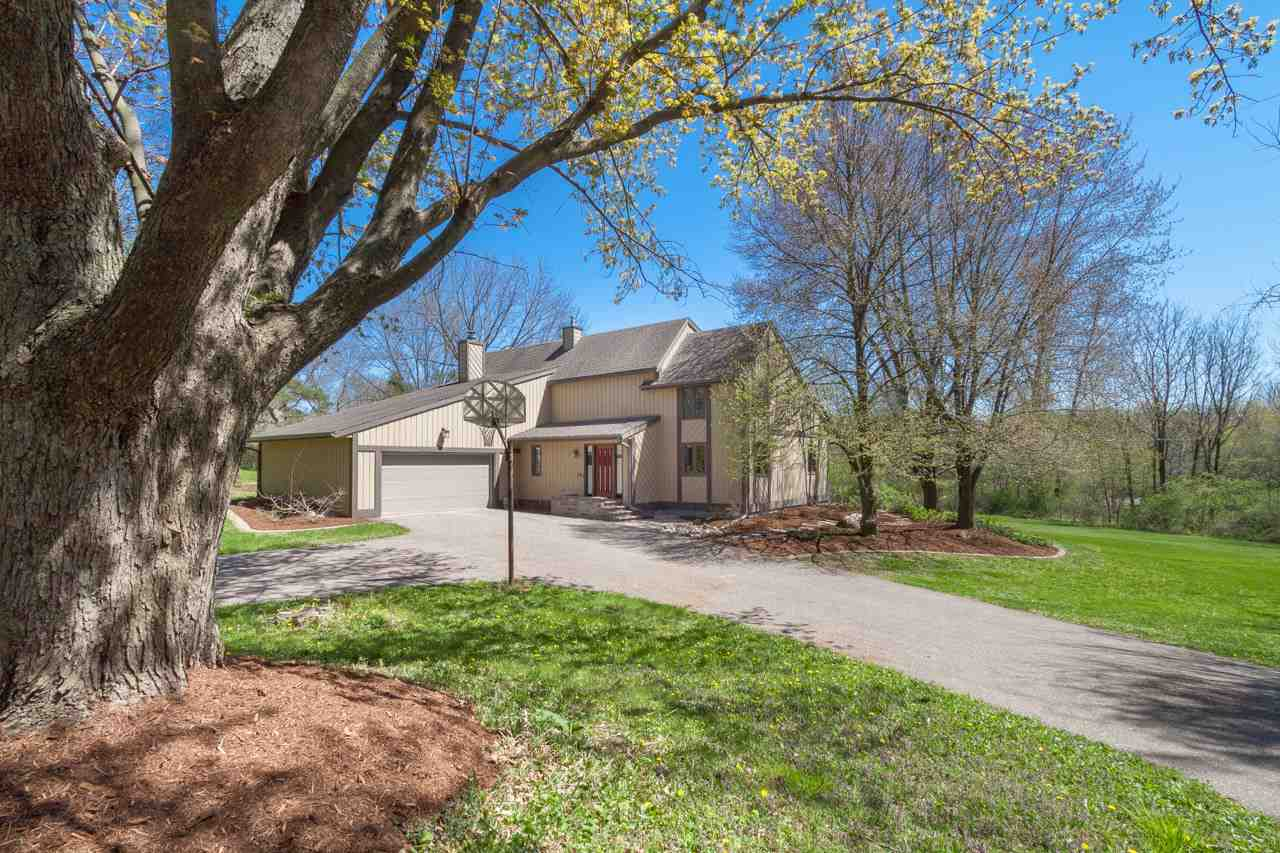This serene, modern home is perched on a beautifully landscaped acre+ yard on a quiet cul de sac.  Adjacent to a park, this is the perfect escape! The double entry welcomes you in to a 2-story foyer w/floating stairs. A few steps to the left and you're in the updated kitchen & dinette which opens to the family rm w/ its wood burning fireplace. Filled w/natural light, it's the perfect place to entertain. Through the kitchen is the formal dining room with unique chevron wall. A step down and you're in the cozy living room. The main level also has a spacious laundry/mudroom and office. The upper level bedrooms include the master suite with Juliet balcony + walk-in closet + 3 other spacious bedrooms. A ready to finish lower level, plumbed for a bathroom, is ready for your ideas.