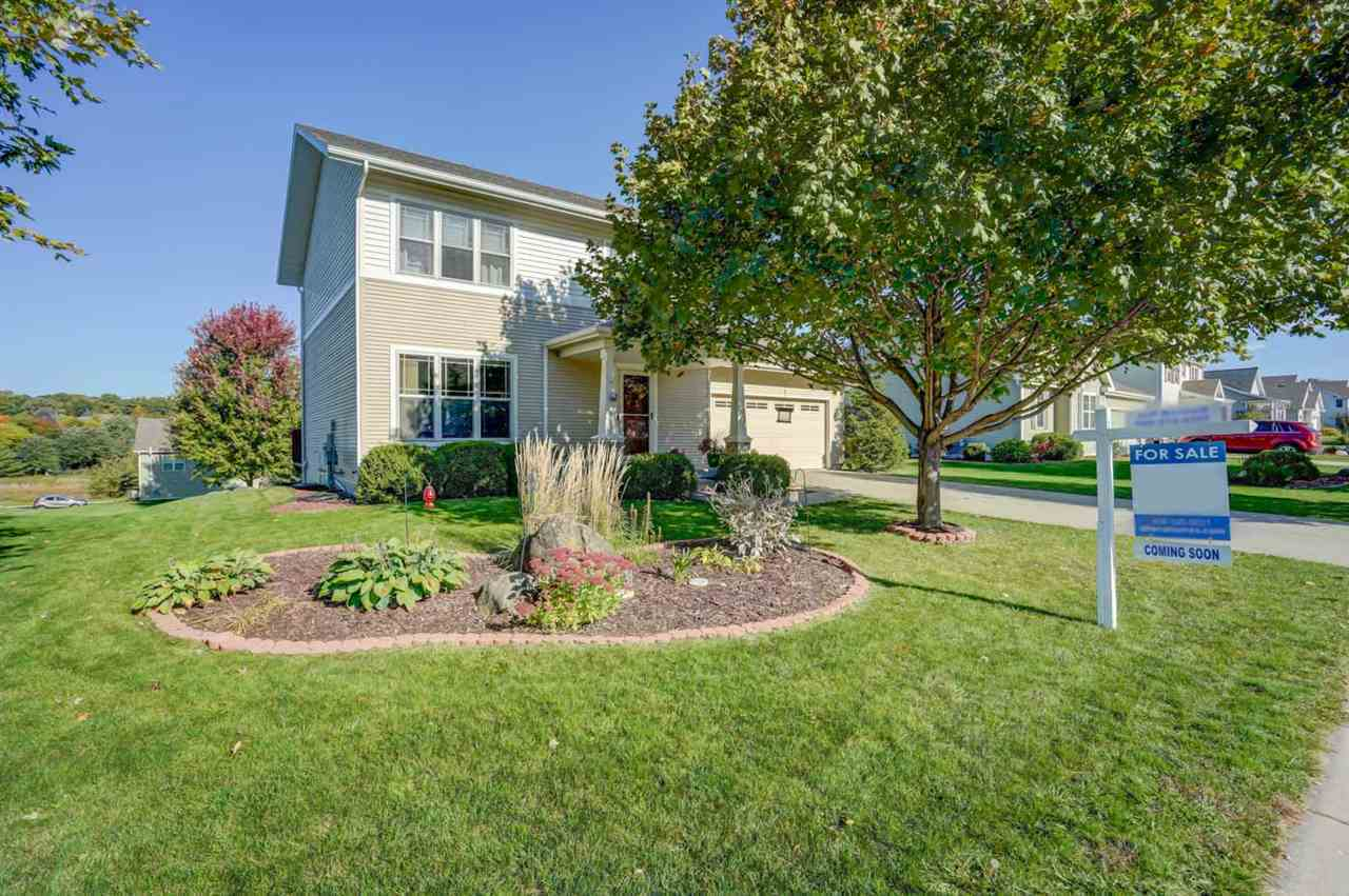Great Eastside Sun Prairie location close to schools, downtown, dining and shopping.  Two story home with rear exposure that backs to a greenspace and bike trail.  Master suite includes walk in closet and full bath.  The kitchen has been updated to include stainless steel appliances, tile backsplash, and pendant lighting.  New flooring throughout the main level.  The lower level has been finished to include family room and half bath.  Full size basement windows allow for plenty of natural light.  Nicely landscaped lot with raised deck off of the kitchen/dining area.