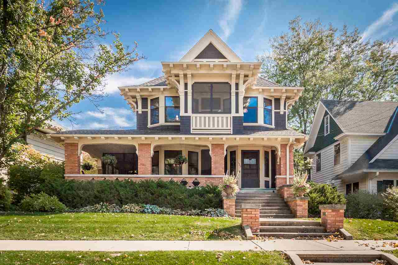 This stunning University Heights beauty, designed by renowned architects Claude & Starck, is an exemplary Craftsman style home. Original features, like Art Nouveau stained glass windows, detailed brick work, ceramic inlays & spectacular woodwork speak to the high level of craftsmanship in this meticulously maintained house. High ceilings, lots of windows, & a flowing floorplan add to the livability, as do modern touches like an eat-in chef's kitchen w/butler's pantry, main floor laundry, thoughtfully renovated bathrooms+the attic & LL which have both been remodeled to accommodate additional bedrooms/rec rooms. The main bedroom is a luxe retreat w/a sitting area, sleeping porch & spa bath. Numerous outdoor spaces—4 screen porches,2 covered porches + a patio. 3+ car garage. Luxury defined!