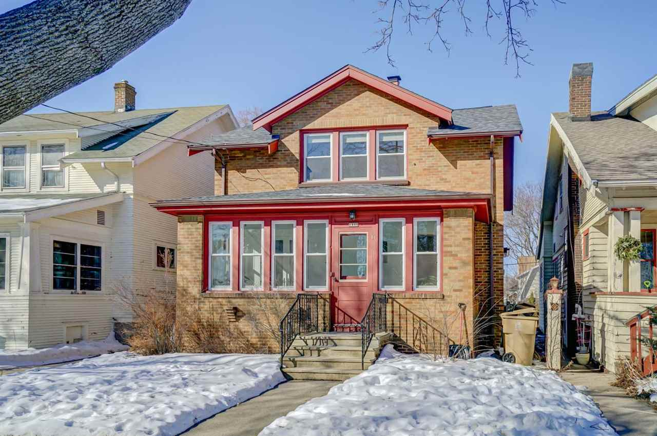 OFFERS WILL BE PRESENTED MONDAY JAN 25th at 10:00 PM. Beautifully updated home on the East Isthmus, with a Lake Monona view, kitty-corner from Morrison Park. Nearly every square foot of this house has been re-touched. All the hardwood floors have been refinished, all the walls have been professionally repainted, all the radiators have been replaced with ducts, a new furnace, and central air! All second floors windows replaced, and all the windows in the front 3-season room. Bright and spacious open floor plan. Modern cooks kitchen with quartz counters, stainless appliances, and newer white cabinetry. Two sets of washer/dryers: one on the 2nd floor, one in the basement. New flooring in the basement. This is a fantastic house, in a fantastic location.