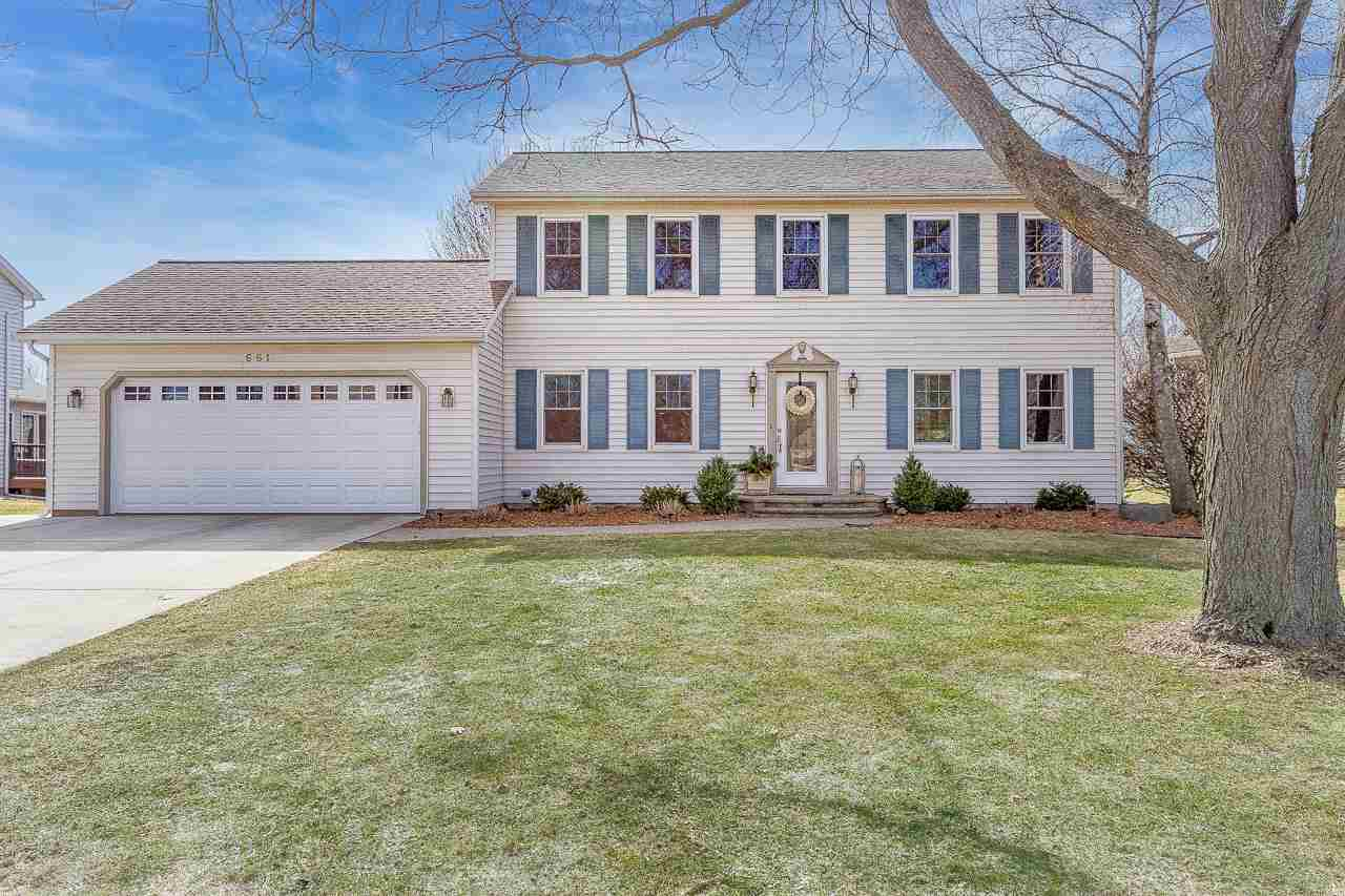 Every square inch of this beautiful Colonial home has been thoughtfully updated w/timeless materials & classic design. The interior is gorgeous, yet the icing on the cake may be the outdoor living space w/fireplace, covered deck, patio & private hot tub. Summer has never been so fun! The patio is easily accessed from the high-end kitchen w/Wolf stove, luxe granite counters+big island that opens to the inviting family room w/fireplace & a light-filled sunroom w/a wood ceiling. The main level also features a formal dining room, large office w/ fantastic built-ins & laundry. A finished LL rec room has great space for entertaining + an exercise room. The remodeled main suite has an envy inspiring closet + modern bathroom; the other 3 bedrooms are spacious, too. Stunning!