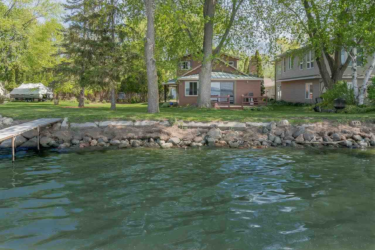 75' of beautiful, sandy Lake Kegonsa shoreline is yours to enjoy in this wonderful lake home!  Let your dreams come true as you sit by the shore and take in the beauty. Bright open spaces in which to enjoy the view with a wall of windows on the lakeside. Or, feel the toasty heat from the brick fireplace as the chill sets in for the winter. Updated, delightful kitchen open to the dining and great room. Large primary suite with private bath on the upper level. Attached garage. The possibilities are endless with this large lake lot, room to add on or keep large yard for outdoor recreation. Great location! Walk to the local supper club, or enjoy wilderness trails that take you to Lake Waubesa, Lake Kegonsa State Park only minutes away and the edge of Madison just 15 minutes away!