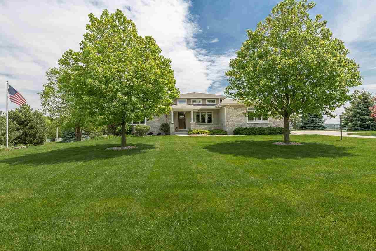 This gorgeous warm + modern ranch home on 1.5 acres will steal your heart with its spectacular horizon views of Lake Mendota & the Capitol. Enjoy the sunrise w/your morning coffee in the sunroom or on the deck, or marvel at the full moon over the Capitol framed by rolling farmland & a canopy of trees. Inside is just as inviting w/airy, open spaces + beautiful hickory floors. The serene great room has a vaulted ceiling & gas fireplace which can also be enjoyed from the kitchen & dining area. Channel your inner Julia Child in the chef's kitchen while impressing loved ones seated at the large island. The ideal main level floor plan includes the primary suite + 2 bedrms & laundry. A sprawling, walkout LL has a rec rm w/a fireplace, bedroom & big office/theater/exercise rm. Middleton schools.
