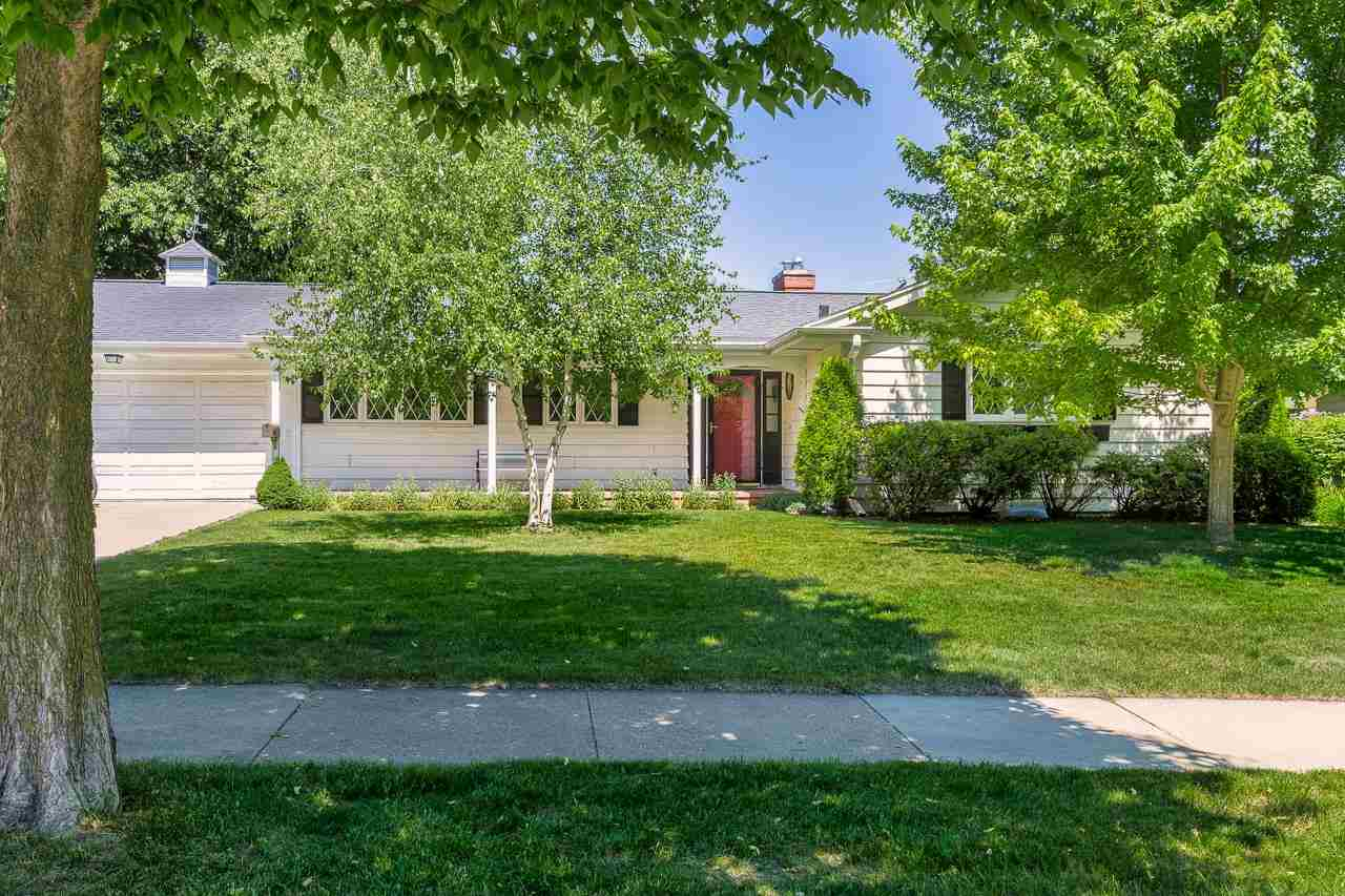 Showings start 6/12 @2pm. A Hill Farms ranch w/the ideal layout mid century homes are known for! The large living rm w/fireplace shares space w/ the formal dining room which also enjoys a view of the fire. They both overlook the 3-season porch that extends the length of the space. You can take in the beautifully landscaped, fenced yard lined w/mature trees from the porch, or head to the shaded patio for an al fresco meal. Or, dine in the bright, eat-in kitchen w/dinette & abundant cabinet space. 3 bedrms, 2 full baths + a laundry closet share the other half of the main level. The LL rec rm w/cedar closet is great for an office + more & has lots of storage space. This lovely home has so much to offer, whether you're ready to move in, or want to make it your own. Walk to Hilldale & schools.