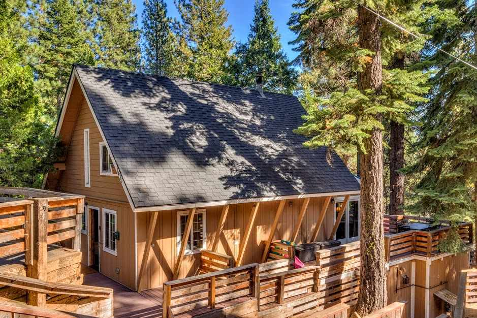 This charming cabin offers modern conveniences with mountain touches. Features 4 beds + 3 baths, with 2 decks and a private patio. Spacious mudroom at entry makes for easy unloading on a ski day. The open layout with kitchen and living room on the main floor is a great space for a family get-together, or unwind to a more intimate sitting area downstairs complete with 2 bedrooms and full bath. Upstairs offers 2 more bedrooms with full bath. Short walk to the bike path, restaurants & private Tahoe Park beach.